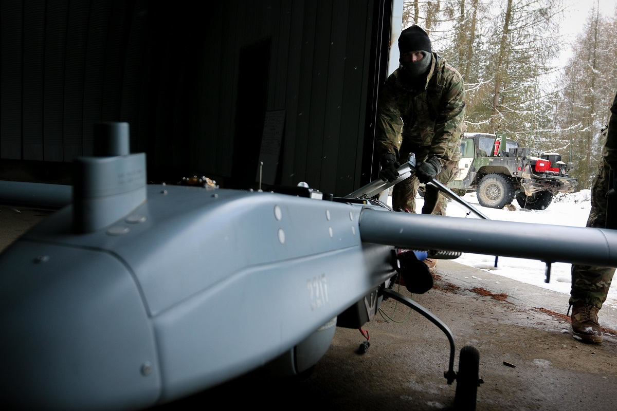 An unmanned aircraft systems repairer moves an RQ-7 Shadow UAV during training at Hohenfels Training Area, Germany, on Jan. 22, 2018. (Spc. Hubert D. Delany III/U.S. Army)