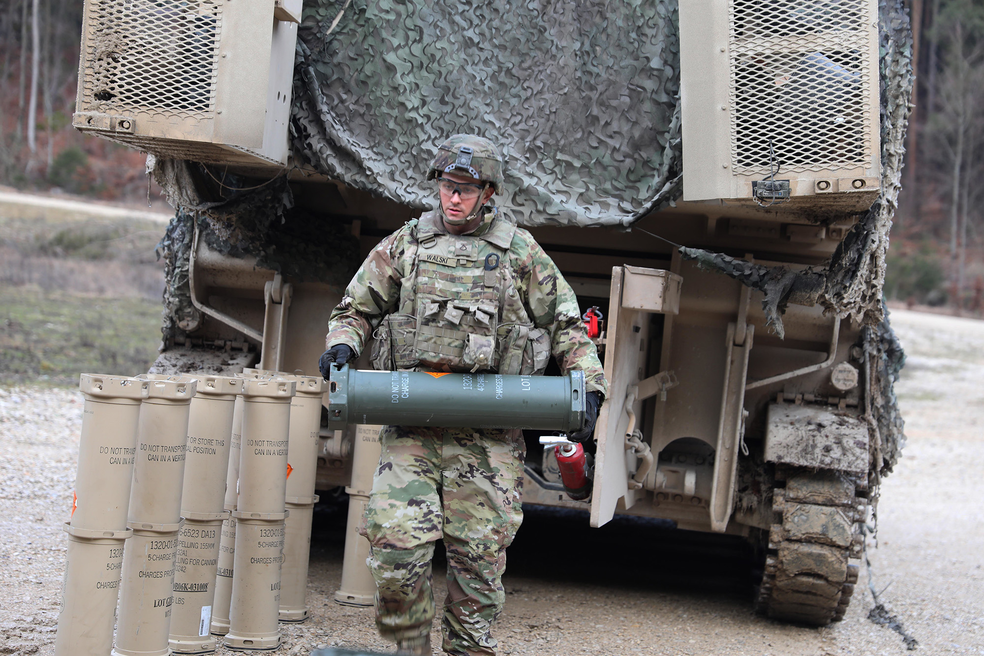Pfc. Christopher Walski loads 155mm rounds into their Carrier, Ammunition Transport (CAT) in preparation of a Jan. 14, 2020, live-fire exercise in Grafenwoehr, Germany. (Sgt. Megan V. Zander/Army National Guard)