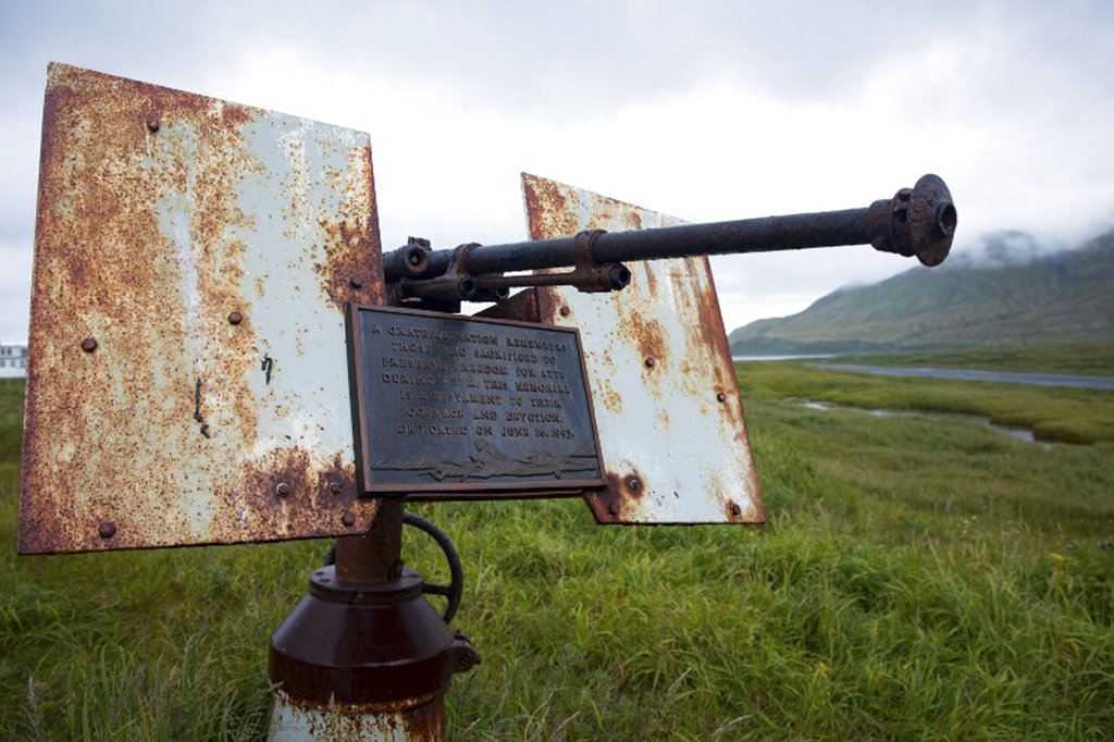 In this Aug. 22, 2017, photo provided by the U.S. Fish and Wildlife Service, an artillery monument sits above Massacre Bay on Attu Island, Alaska. One of the bloodiest World War II battles in the Pacific was waged 75 years ago this month on Attu Island in Alaska's Aleutian Islands. American forces reclaimed the island on Memorial Day 1943, 11 months after Japan seized it. (Lisa Hupp/U.S. Fish and Wildlife Service via AP)