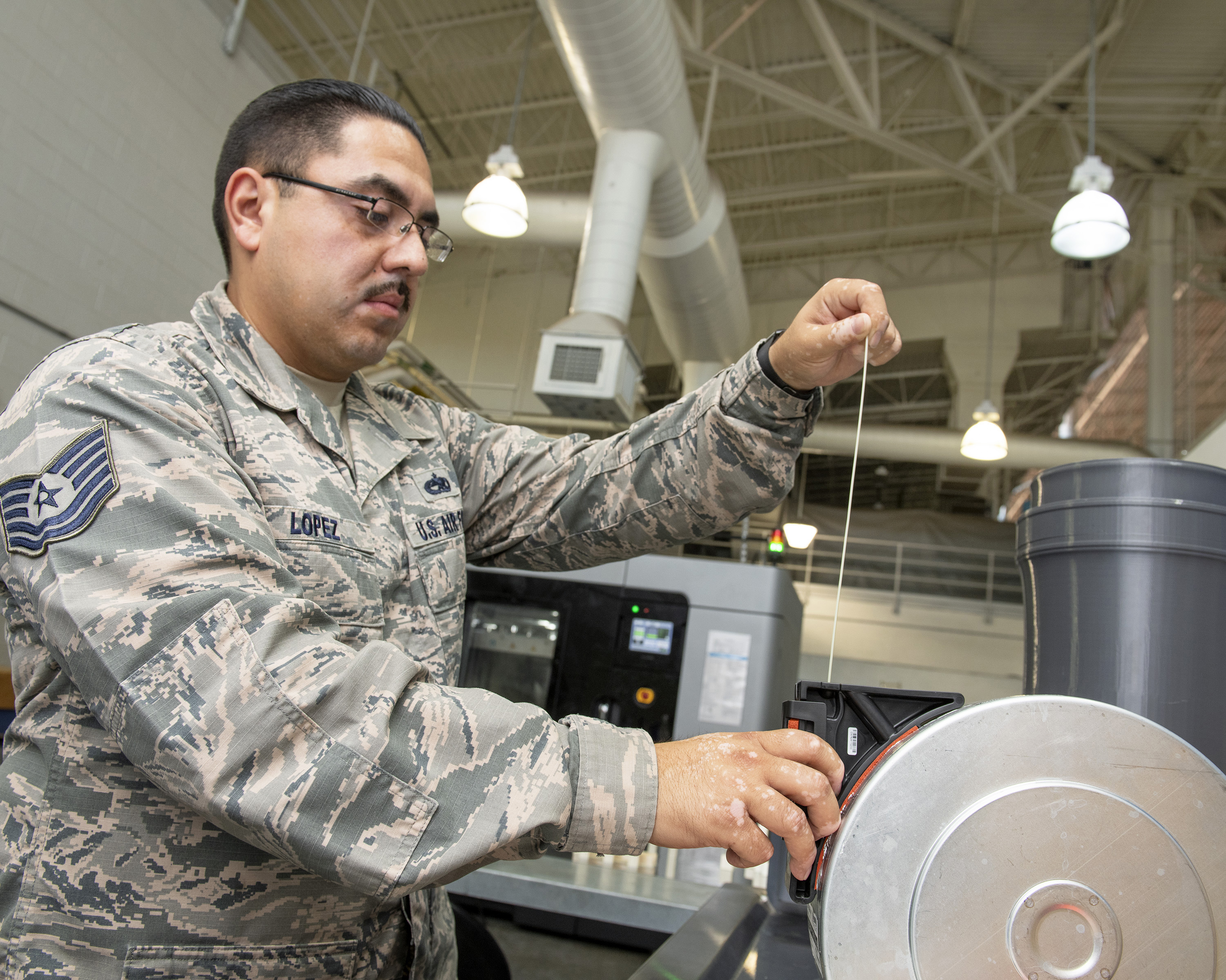 Travis Air Force Base, California, is the first installation to have the Stratays F900 3D industrial printer certified by the Federal Aviation Administration and Air Force Advanced Technology and Training Center for use on aircraft replacement parts. (Louis Briscese/Air Force)