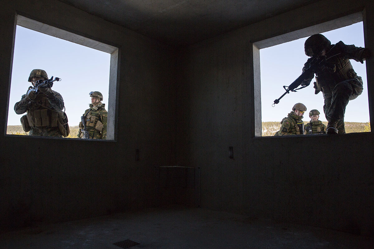 Marines with Marine Rotational Force-Europe 18.1 complete a Norwegian room-clearing technique during close-quarters combat training in Norway on March 27. (Gunnery Sgt. Clinton Firstbrook/Marine Corps)