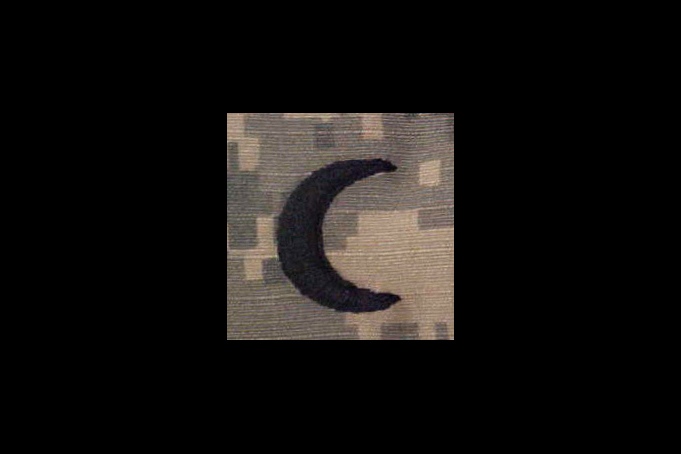 A crescent moon patch is seen on a Muslim chaplain's uniform while serving in Iraq in 2008.