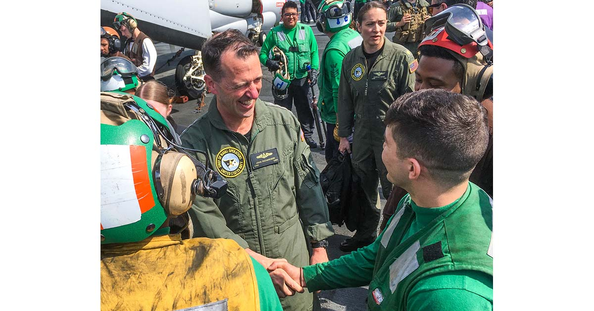 Chief of Naval Operations Adm. John Richardson spends time meeting sailors during a break in flight operations May 13, 2018, onboard the aircraft carrier George H. W. Bush with the French Navy. (Mark D. Faram/Staff)