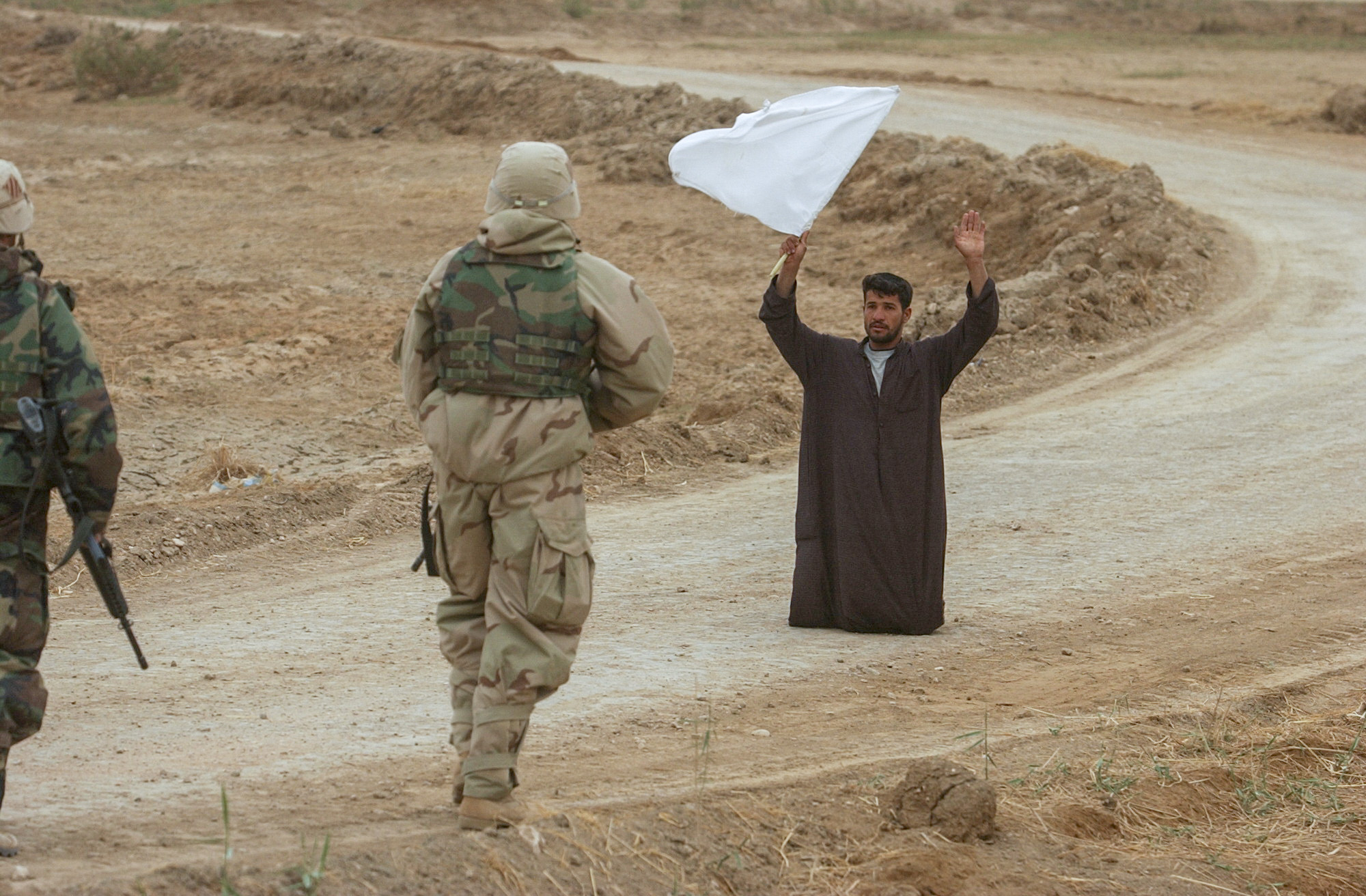 An Iraqi surrenders to Soldiers from 3rd ID. (Warren Zinn/Army Times)