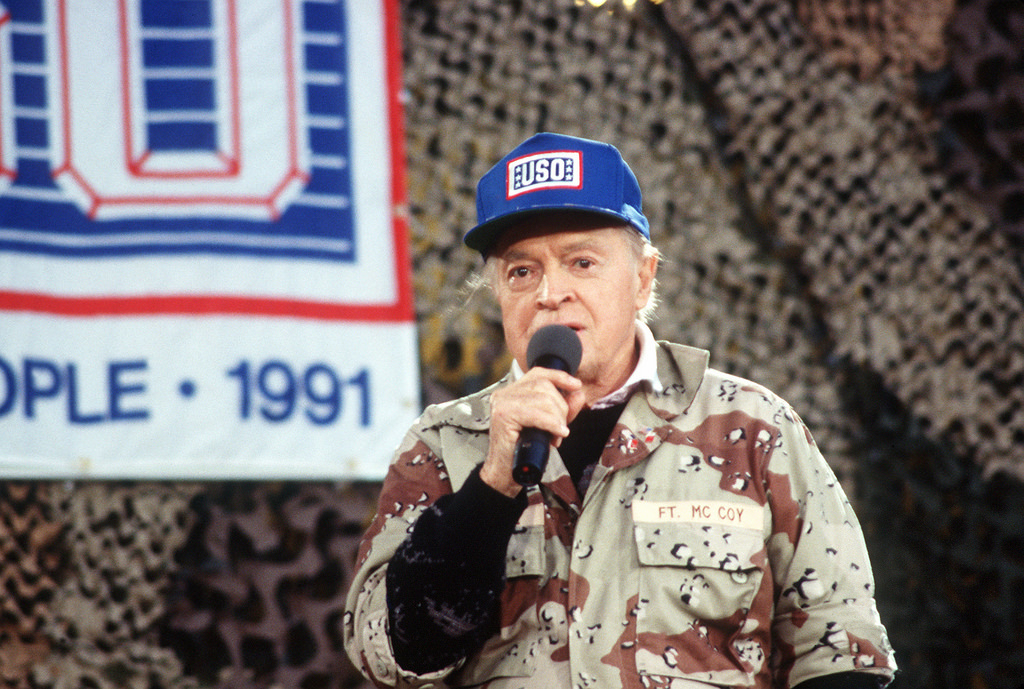 Entertainer Bob Hope performs for military personnel at the USO Christmas Tour during Operation Desert Shield. (Air Force)