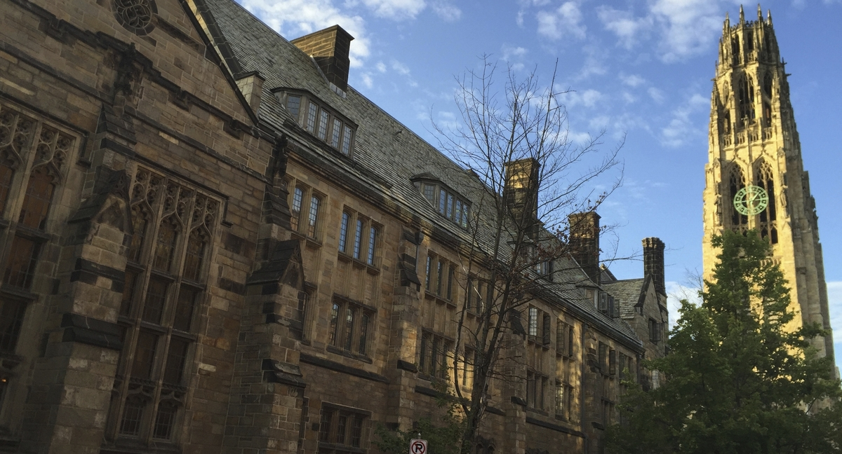 This Sept. 9, 2016, photo shows Harkness Tower on the campus of Yale University in New Haven, Conn. A 2019 Veterans Day protest in which a student placed red-painted latex gloves over small American flags on campus, has stirred controversy at the university. (Beth J. Harpaz/AP)