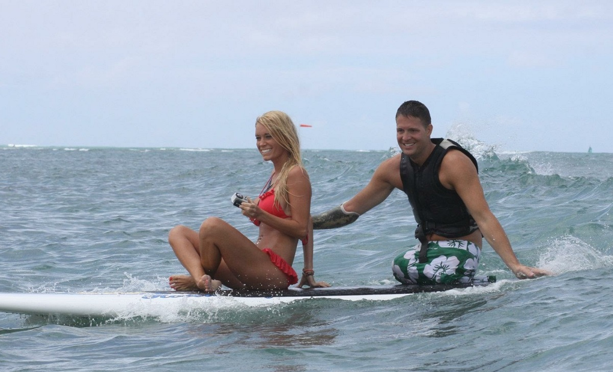 Ashley and Brian Kolfage practice surfing. The couple married in 2011. (Photo courtesy of Ashley Kolfage)