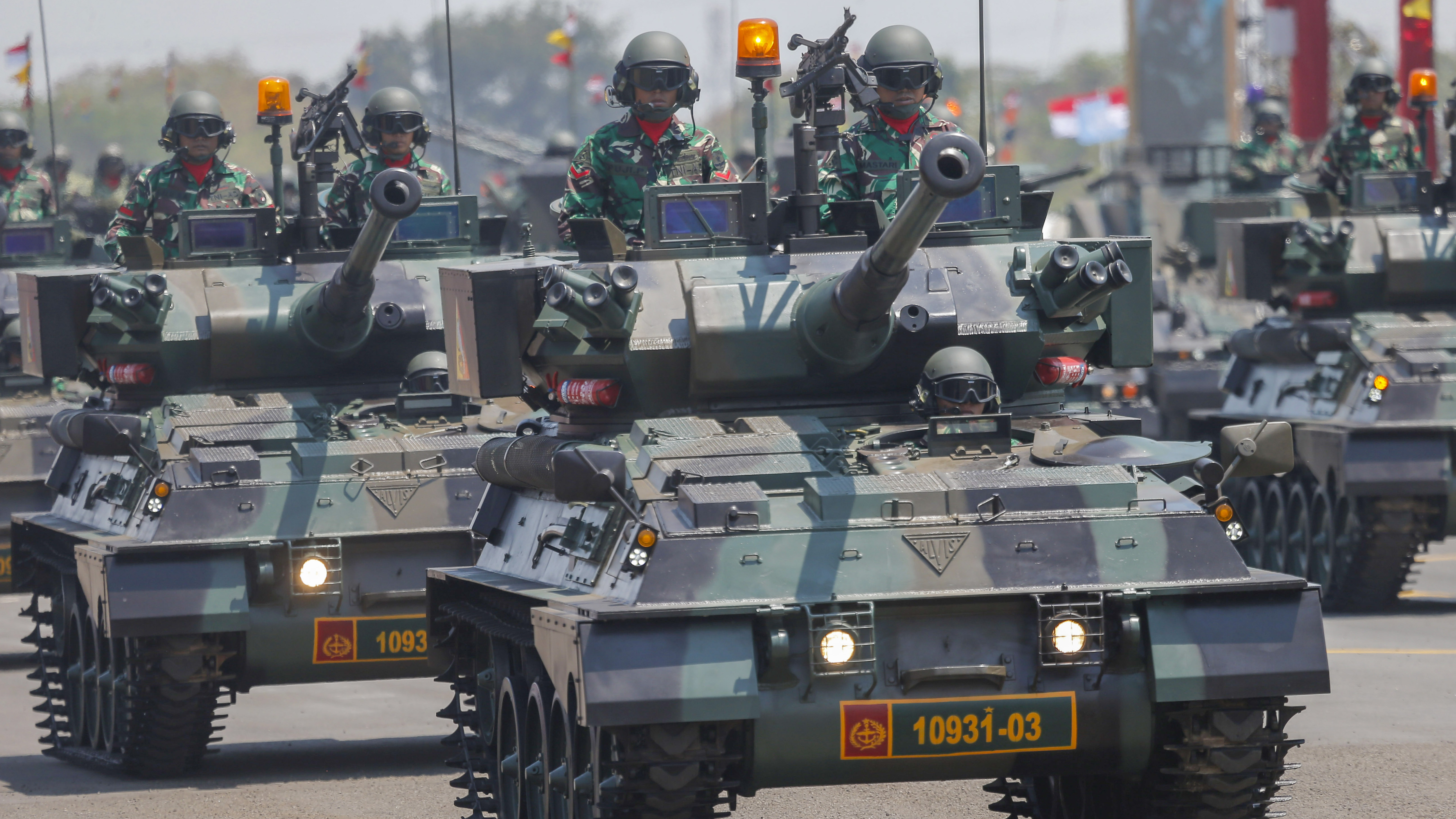 Indonesian soldiers parade on tanks march during a parade marking the 74th anniversary of the Indonesian Armed Forces in Jakarta, Indonesia, Saturday, Oct. 5, 2019. (AP Photo/Tatan Syuflana)