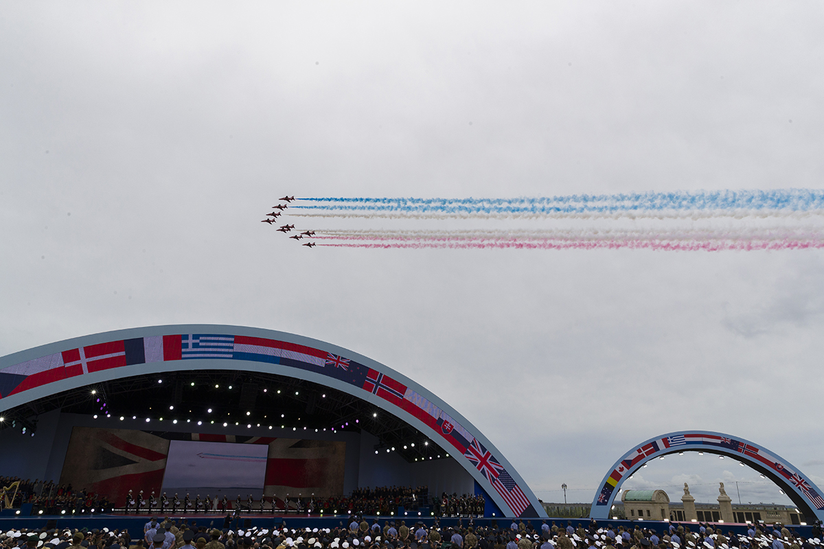 A flyover trails colored smoke to conclude a ceremony to mark the 75th Anniversary of D-Day, when the Allied soldiers, sailors and airmen conducted an invasion that helped liberate Europe from Nazi Germany, Wednesday, June 5, 2019, in Portsmouth, England. (Alex Brandon/AP)
