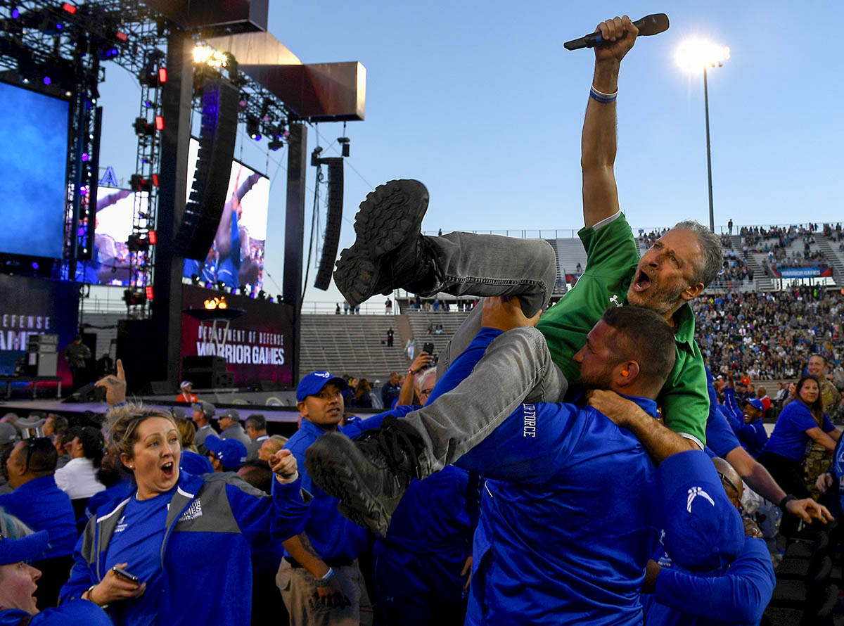 Actor and television personality Jon Stewart is hoisted up in the air by members of Team Air Force during the opening ceremony of the Department of Defense Warrior Games at the U.S. Air Force Academy in Colorado Springs, Colorado, June 2, 2018. First held in Colorado Springs in 2010, the Warrior Games were established as a way to expose service members who were wounded, ill or injured to adaptive sports. The Air Force is the host service for this year's Games. (Staff Sgt. Rusty Frank/DoD)