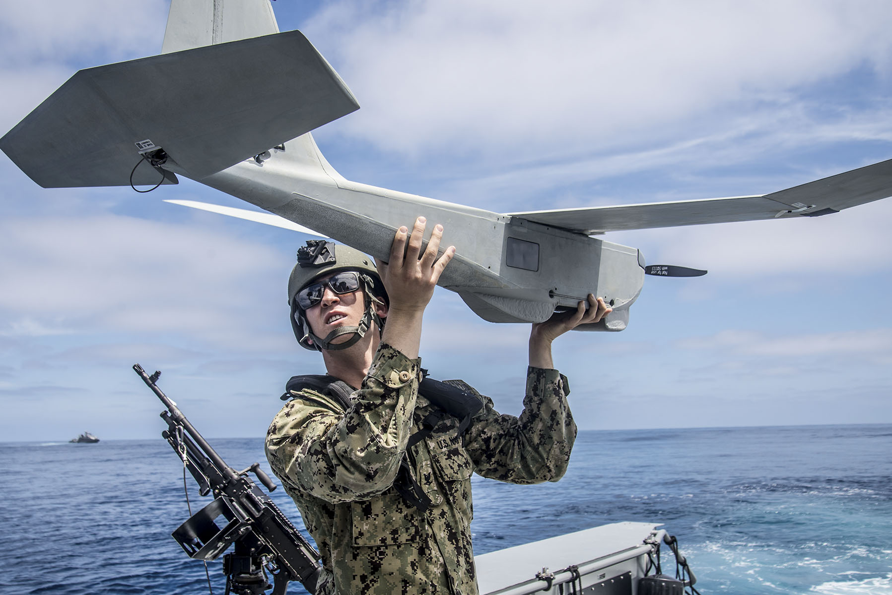 Operations Specialist 3rd Class Neil Wierboski, assigned to Coastal Riverine Squadron 3, prepares the unmanned aerial vehicle for launch aboard a Mark VI patrol boat during training. (BMC Nelson Doromal Jr./Navy)