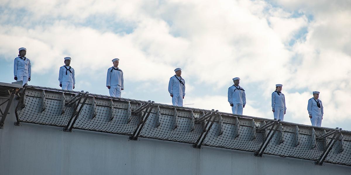 Sailors man the rails on the flight deck of the carrier John C. Stennis in Norfolk. (Mark D. Faram/Staff)