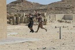 An Omani soldier brings an opposition force detainee to a collection point as part of the exercise. The purpose of Inferno Creek was to conduct theater security cooperation focused on combined arms training and dismounted lane training from team- to platoon-sized elements. (Staff Sgt. Jennifer Milnes/U.S. Army)