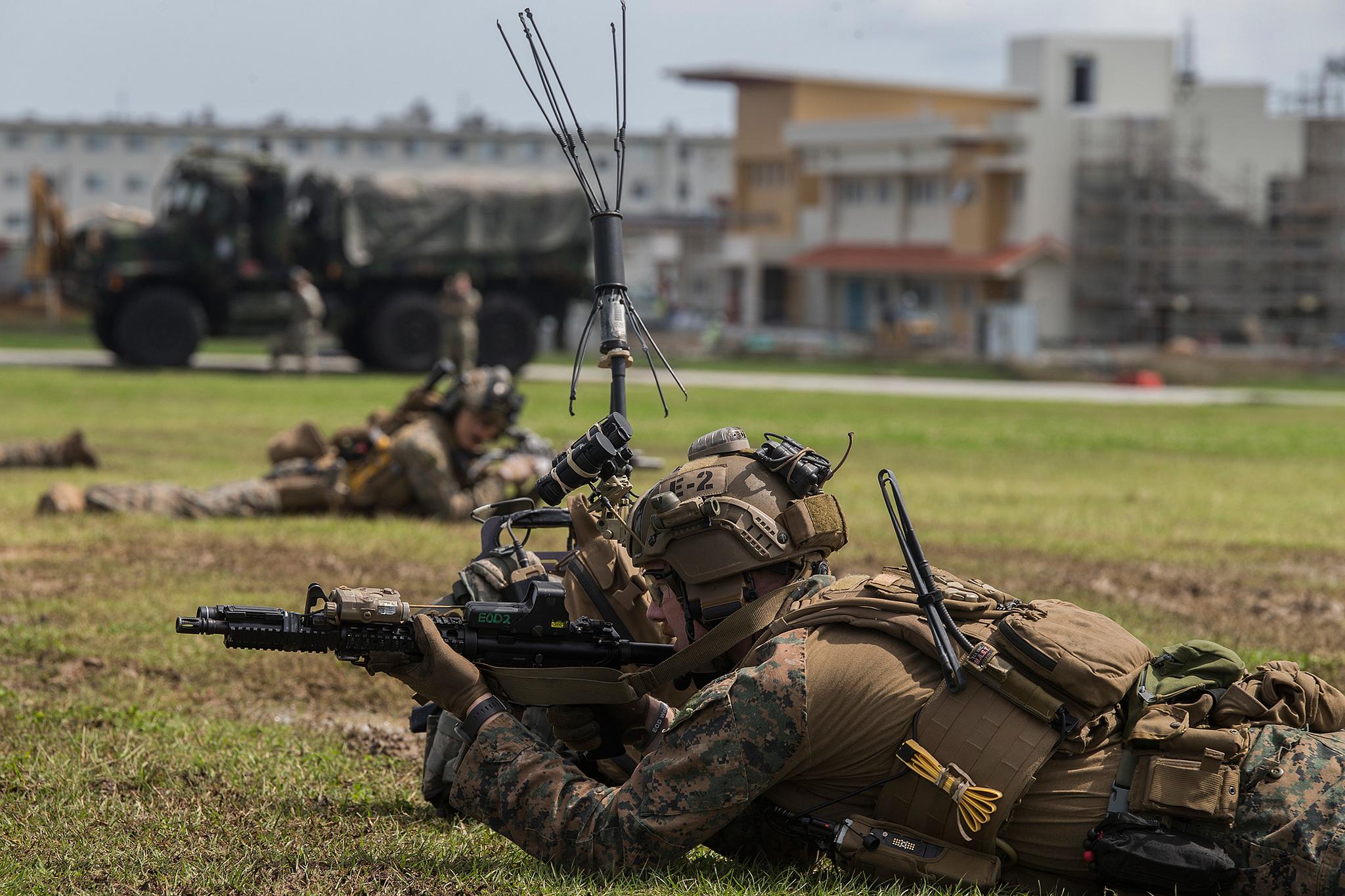 Marines post security during a simulated raid at Camp Hansen, Okinawa, Japan, Feb. 25, 2019. (Lance Cpl. Kyle P. Bunyi/Marine Corps)