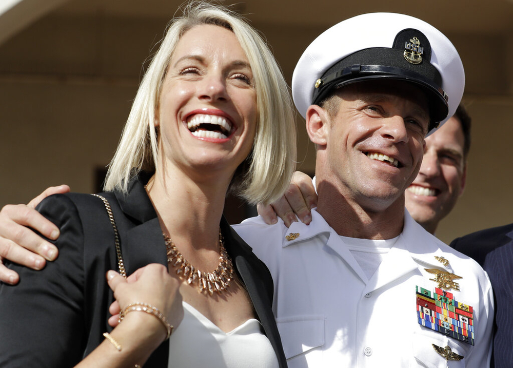 "Special Warfare Operator Chief Edward ""Eddie"" Gallagher , left, and his wife Andrea smile after leaving the Naval Base San Diego courtroom on during his July court-martial trial. (Gregory Bull/AP)"