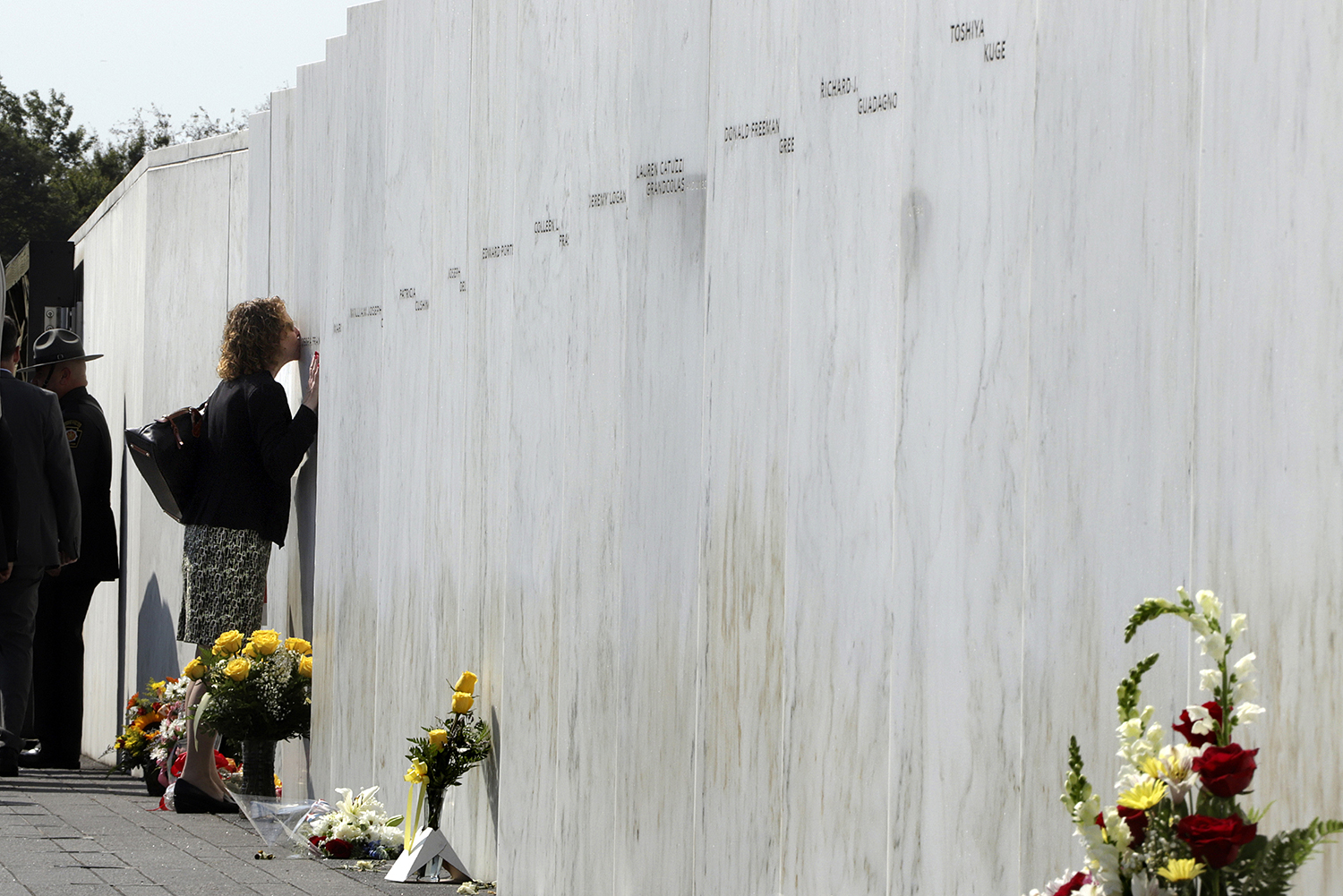 A woman pays respects at the Wall of Names at the Flight 93 National Memorial in Shanksville, Pa. after a Service of Remembrance Wednesday, Sept. 11, 2019, as the nation marks the 18th anniversary of the Sept. 11, 2001, attacks. The Wall of Names honor the 40 people killed in the crash of Flight 93. (Gene J. Puskar/AP)