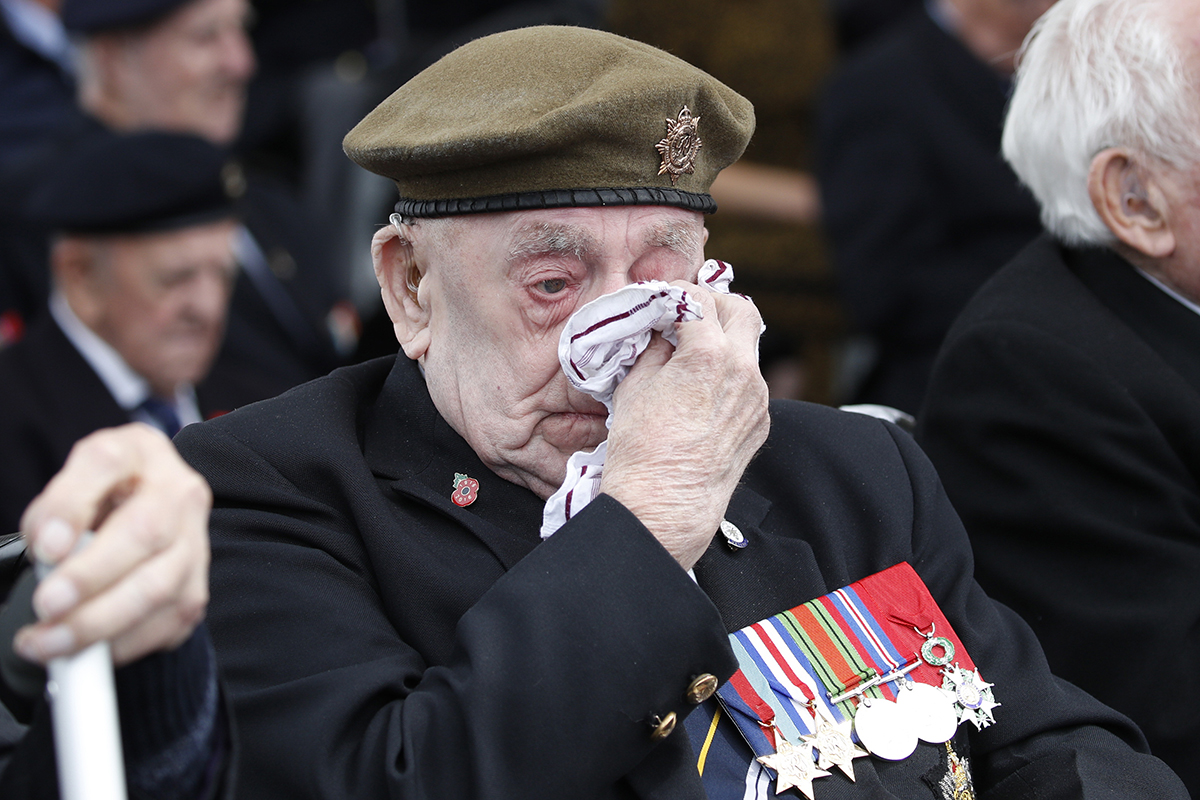 A veteran wipes his eyes during a ceremony to mark the 75th anniversary of D-Day, Wednesday, June 5, 2019, in Portsmouth, England. (Alex Brandon/AP)