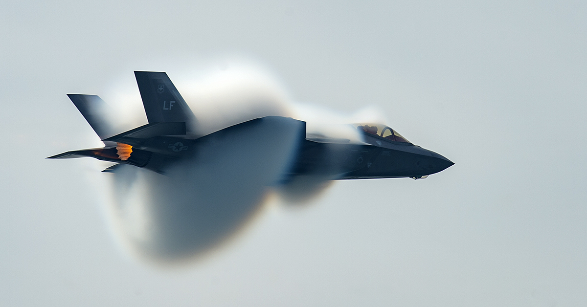 Capt. Andrew 'Dojo' Olson, F-35 Heritage Flight Team pilot and commander, performs a high-speed pass during the Canadian International Air Show in Toronto, Sept. 1, 2018. (Airman 1st Class Alexander Cook/Air Force)