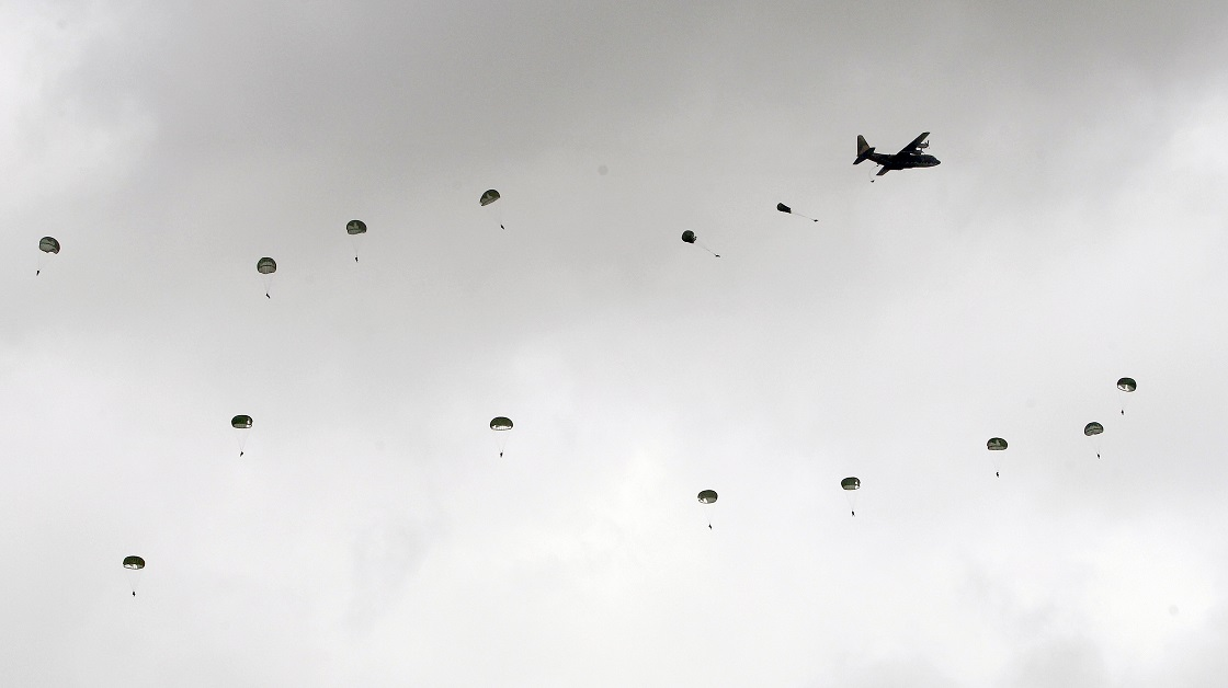 Taiwanese airborne soldiers dot the sky as they deploy from a C-130 Hercules cargo plane. The exercise at the sprawling Ching Chuan Kang force base near the central city of Taichung was part of an annual five-day live-fire exercise featuring joint operations of the Air Force, Navy and ground forces. (Chiang Ying-ying/AP)