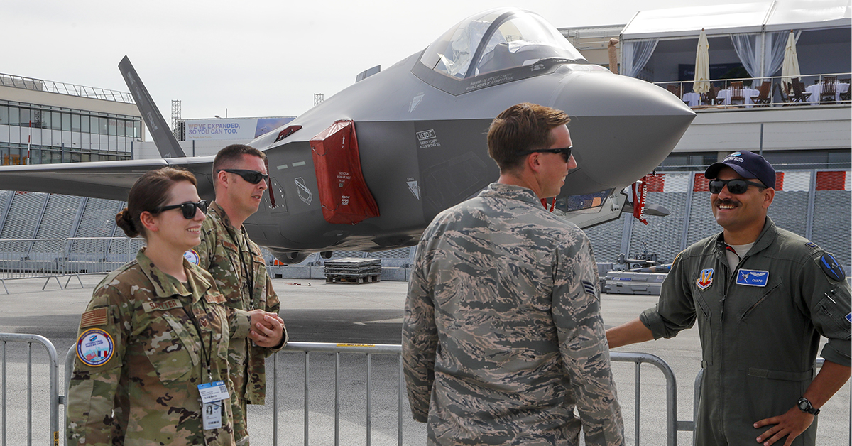 U.S Air Force crew members gather next to an F-35 Lightning II on display at the Paris Air Show. (Michel Euler/AP)