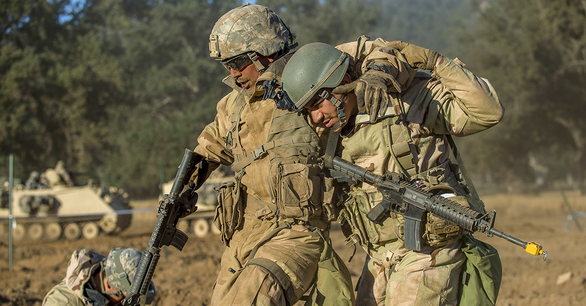 Army Reserve combat engineer Soldier from the 350th Engineer Company, of Bell, California, helps a