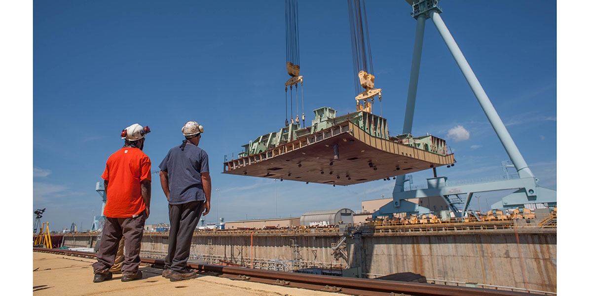 The first keel section of the new Ford-Class carrier John F. Kennedy is put into dry dock 12 at Huntington Ingalls Newport News Shipyard on Aug. 22, 2015. (Mark D. Faram/staff)