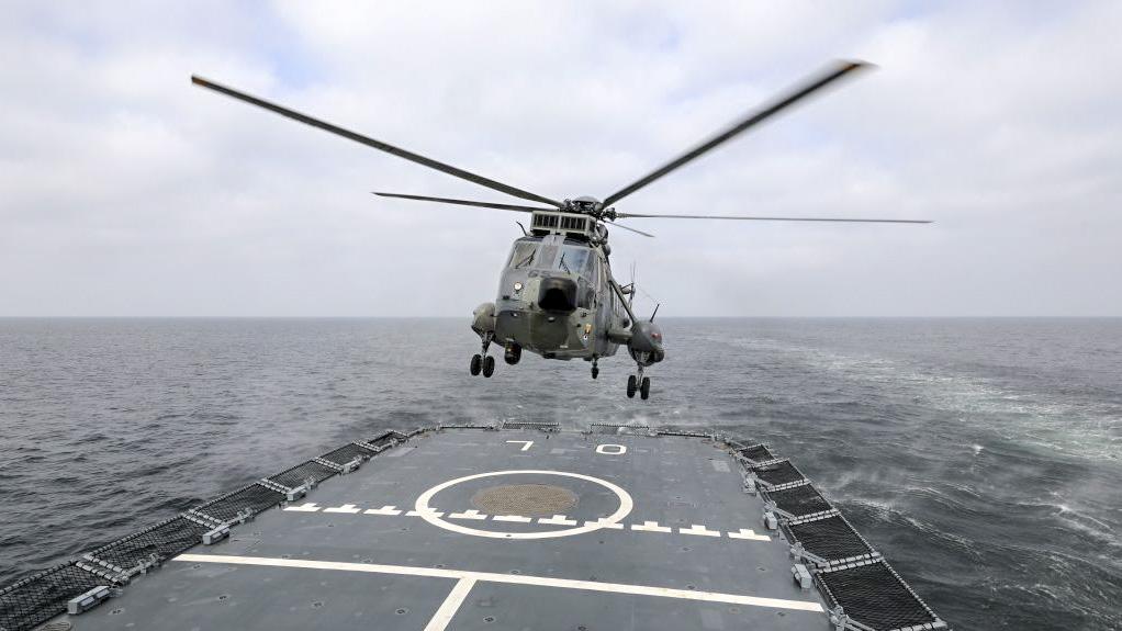 German Defence Minister Annegret Kramp-Karrenbauer lands with an helicopter