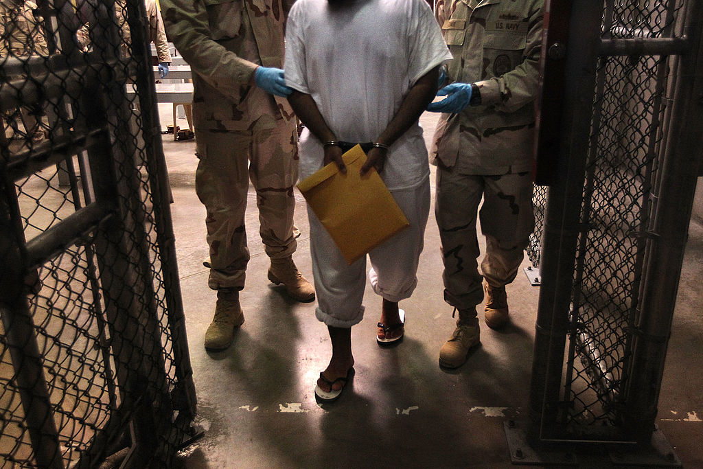 U.S. Navy guards escort a detainee after a