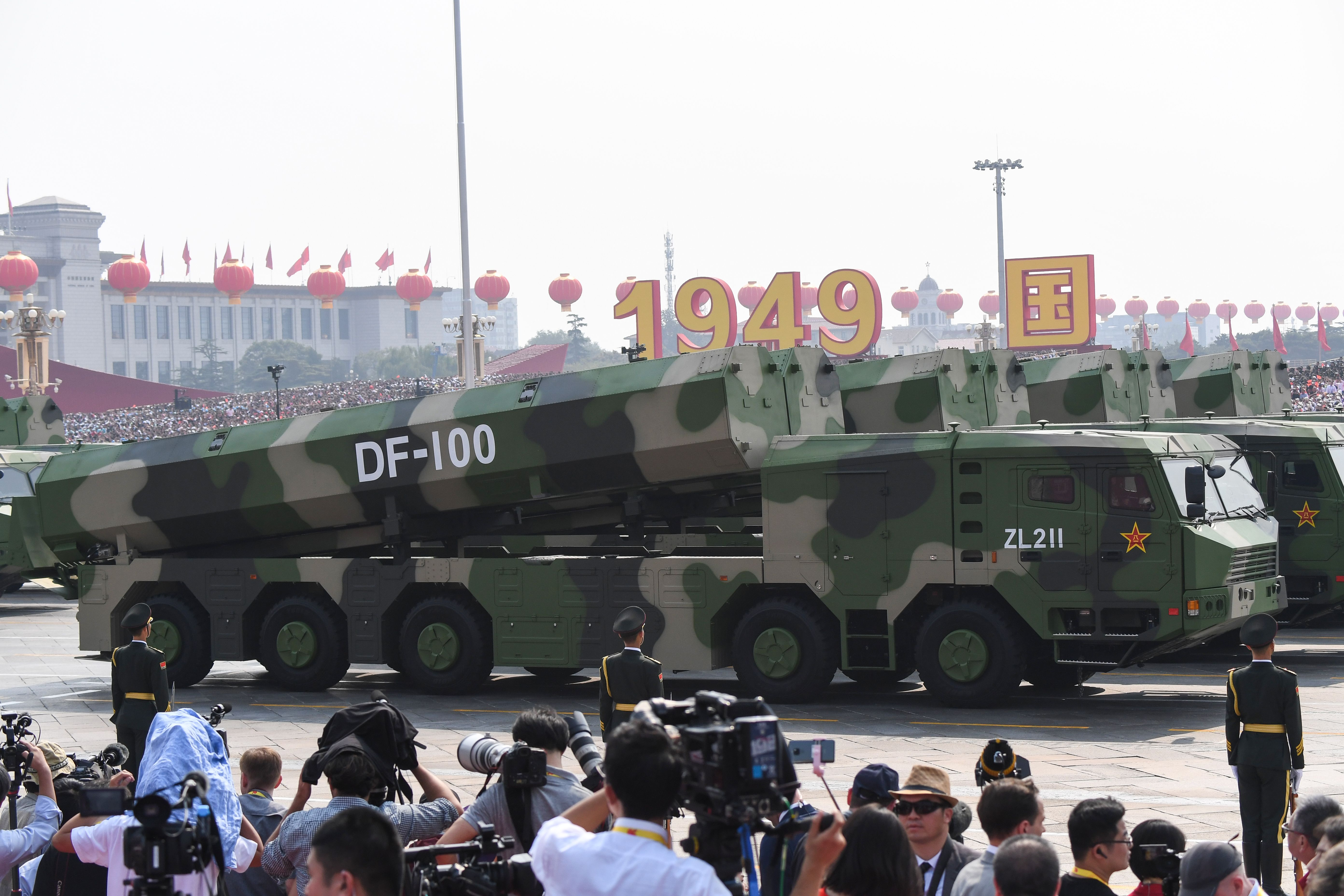 Military vehicles carry DF-100 ground-based land-attack missiles. (Greg Baker/AFP via Getty Images)