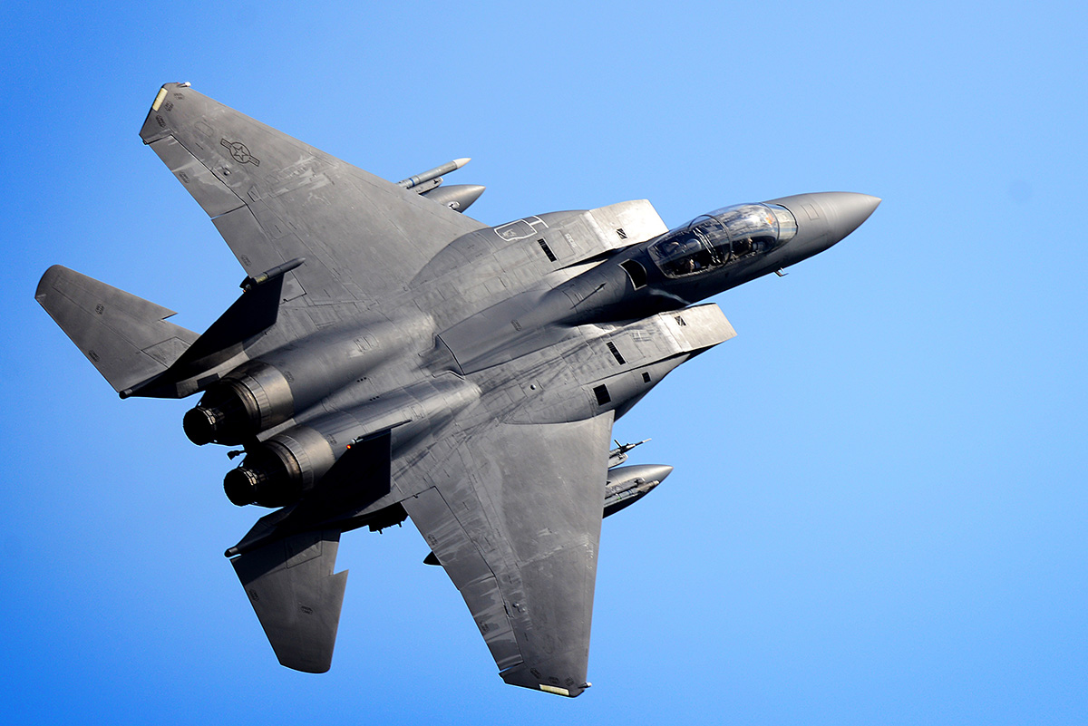 An F-15E Strike Eagle performs a high-speed pass over RAF Lakenheath, England, April 10, 2019. (Tech. Sgt. Matthew Plew/Air Force)