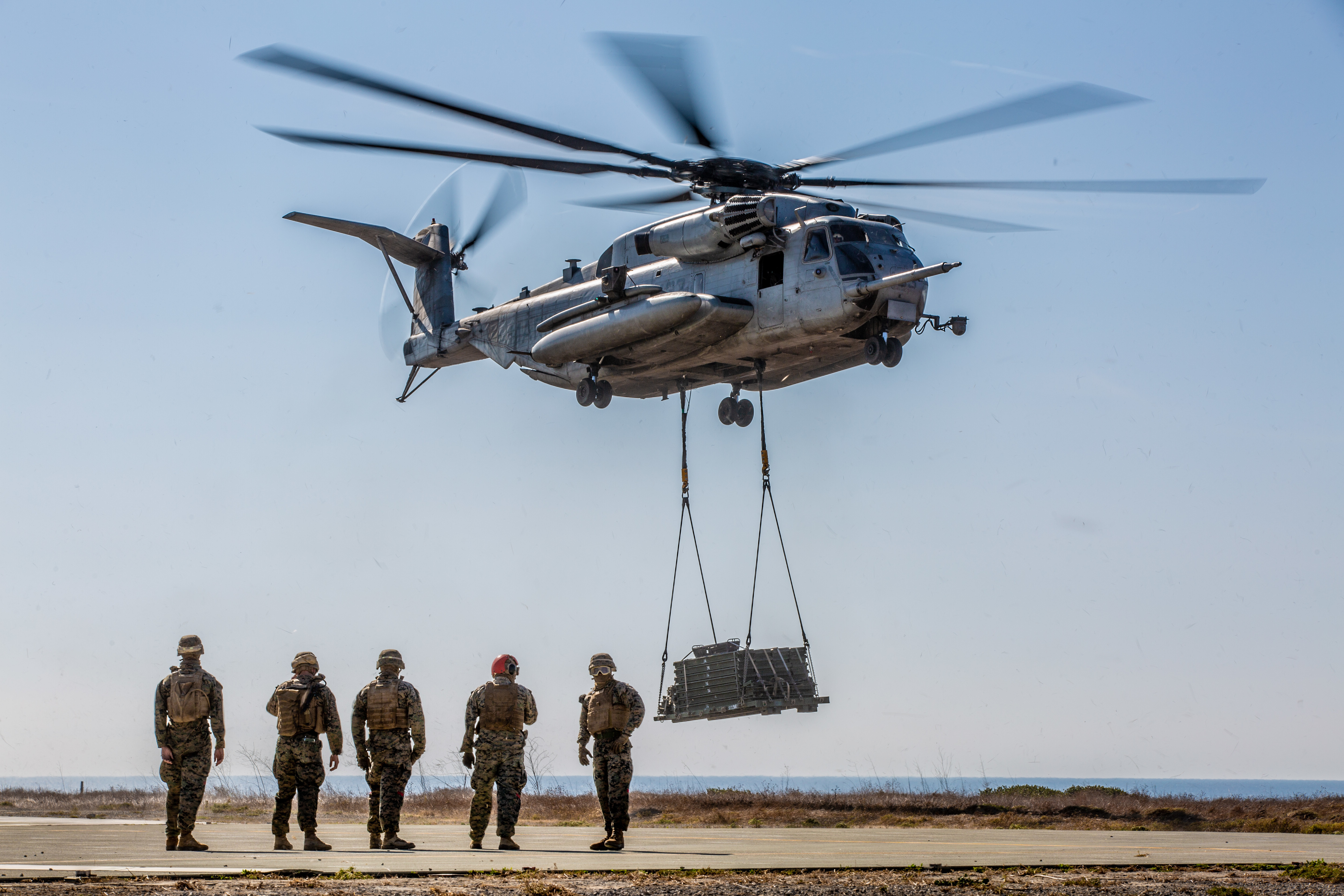 Marines with Landing Support Company, 1st Transportation Battalion, 1st Marine Logistics Group, prepare to detach pallets from a helicopter during Exercise Green Dagger at Camp Pendleton, California, on Nov. 14, 2019. Activities such as this exercise could have been disrupted if a partial government shutdown went into effect this week. (Lance Cpl. Aldo Sessarego/Marines)