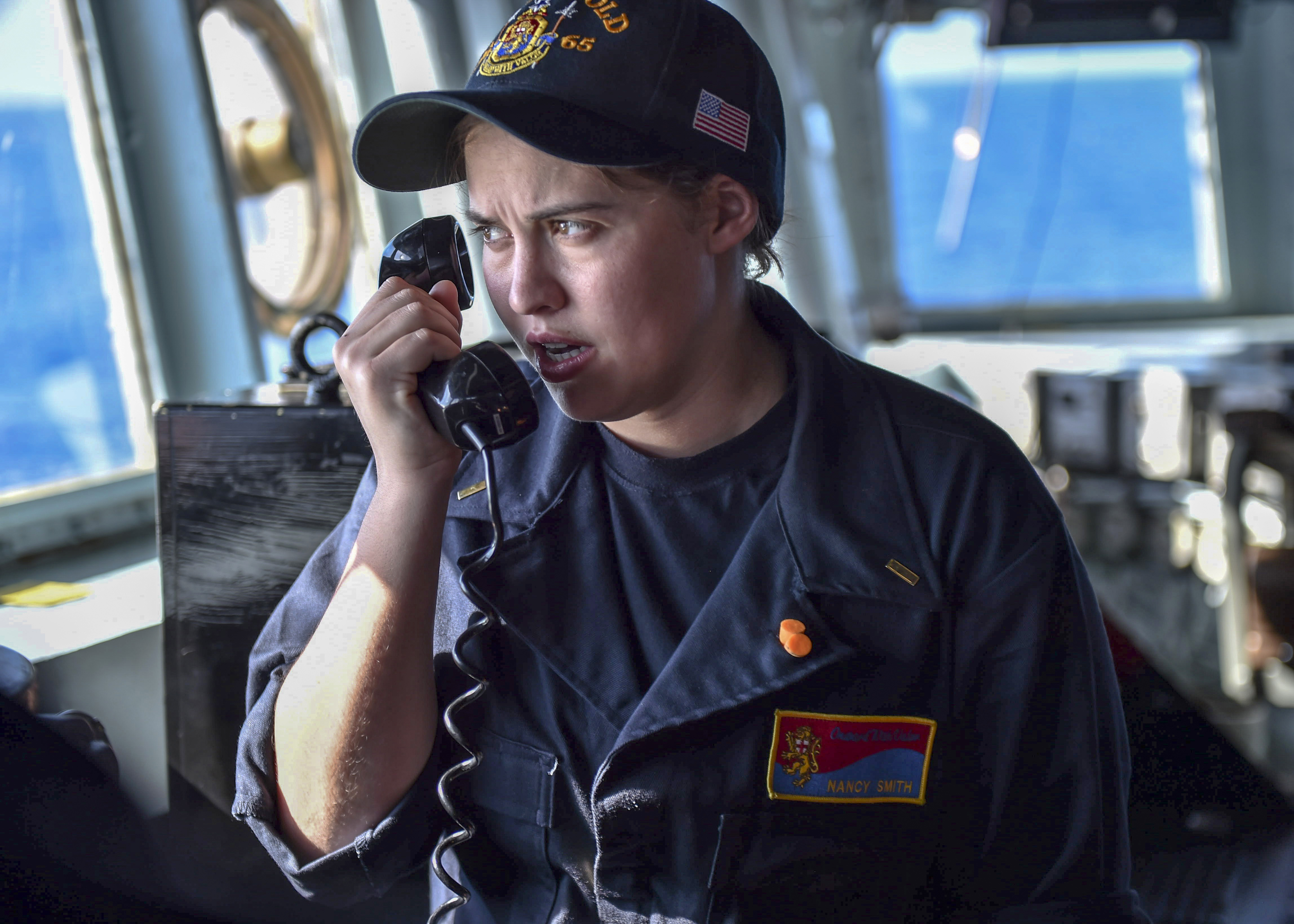Ensign Nancy Smith uses the bridge-to-bridge radio aboard the Arleigh Burke-class guided-missile destroyer USS Benfold (DDG 65) to speak with a marine patrol craft during Multisail 18. Multisail is a bilateral training exercise improving interoperability between the U.S. and Japanese forces. This exercise benefits from realistic, shared training enhancing our ability to work together to confront any contingency. (MC1 Benjamin Dobbs/Navy)