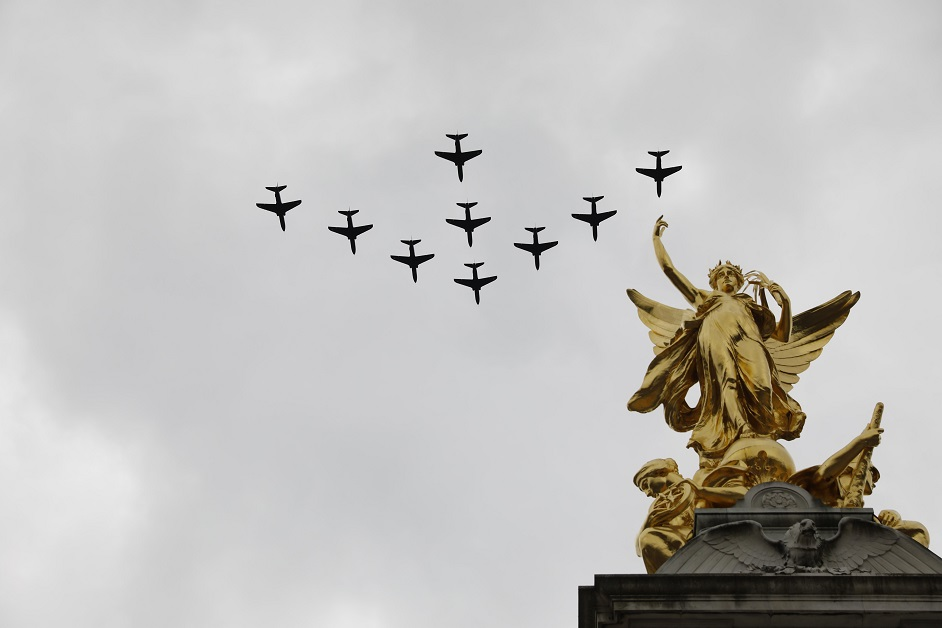 Military aircraft form a tight formation over the Queen Victoria Memorial on the Mall outside Buckingham Palace in London. (Tolga Akmen/AFP via Getty Images)