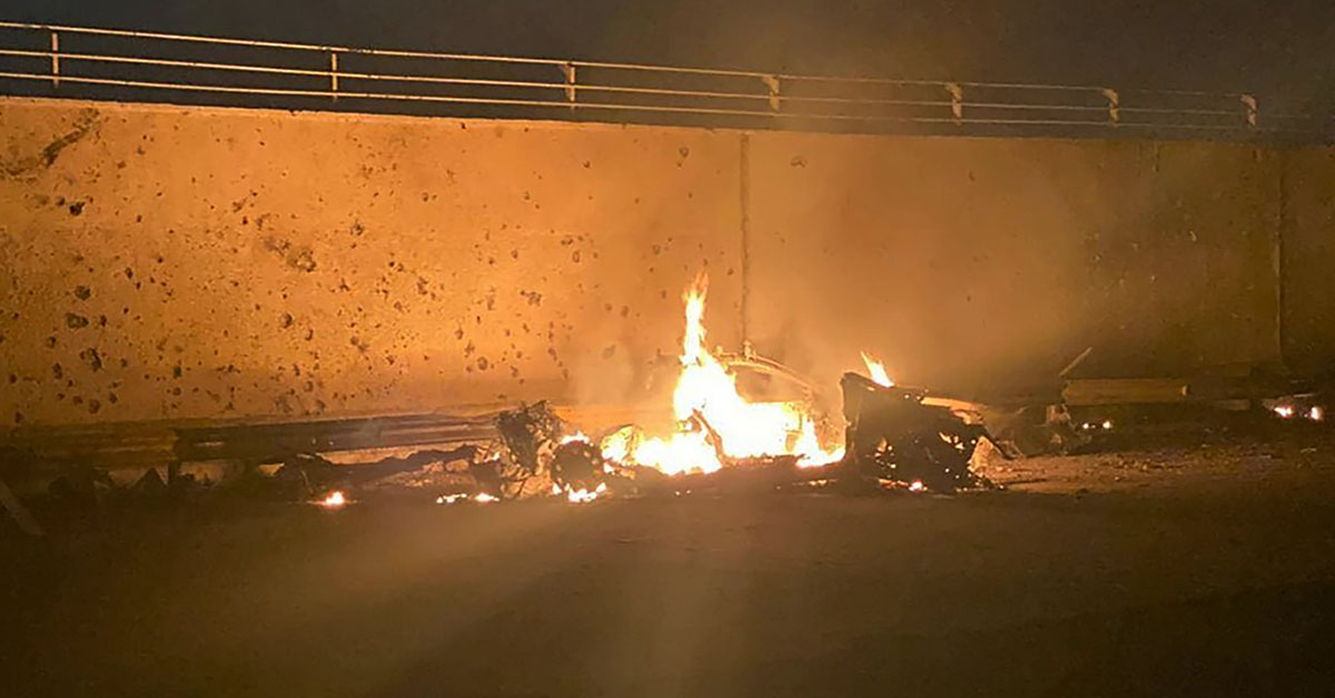 This photo released by the Iraqi Prime Minister Press Office shows a burning vehicle at the Baghdad International Airport following an airstrike, in Baghdad, Iraq, early Friday, Jan. 3, 2020. The Pentagon said Thursday that the U.S. military has killed Gen. Qassem Soleimani, the head of Iran's elite Quds Force, at the direction of President Donald Trump. (Iraqi Prime Minister Press Office via AP)