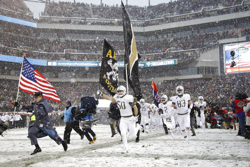 Army West Point players take the field before Saturday's Army-Navy game in Philadelphia. (Matt Rourke/AP)