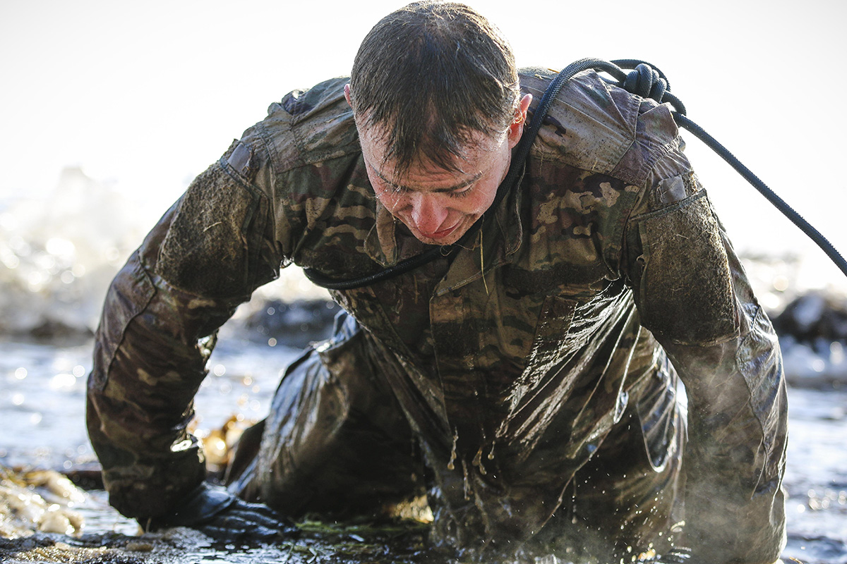 Spc. Logan Muir, a Bowie, Maryland native and a wheeled vehicle mechanic with the 82nd Brigade Engineer Battalion, 2nd Armored Brigade Combat Team, 1st Infantry Division, completes cold-water immersion training with the U.K. 1st Royal Welsh Battalion in Tapa, Estonia on March 7, 2018 as part of a rapid response readiness exercise in support of Atlantic Resolve. T(Spc. Hubert D. Delany III/Army)