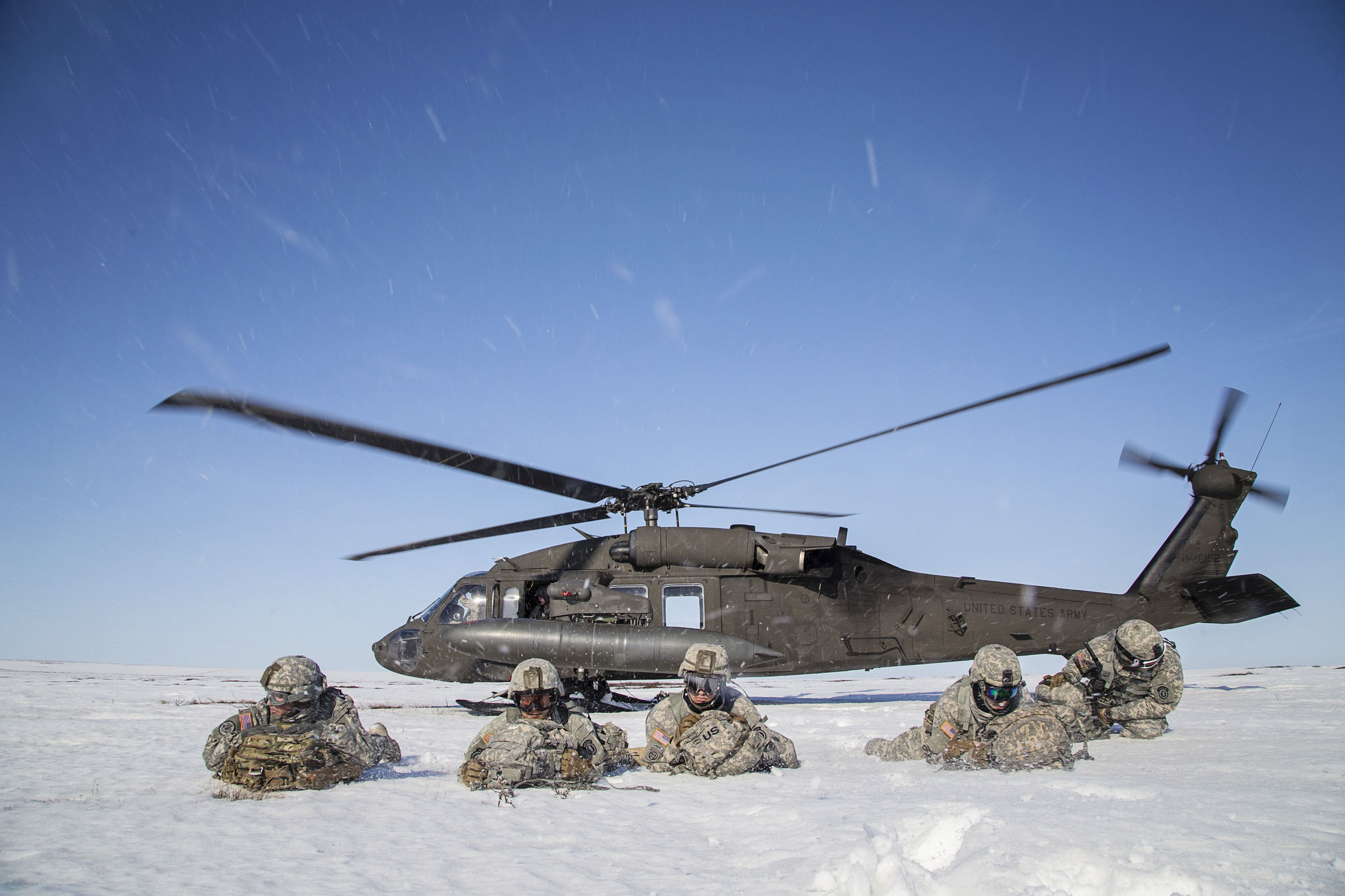 Paratroopers pull security after exiting a UH-60 Black Hawk helicopter during exercise Arctic Pegasus near Deadhorse, Alaska, May 1, 2014. (Sgt. Edward Eagerton/Army National Guard)