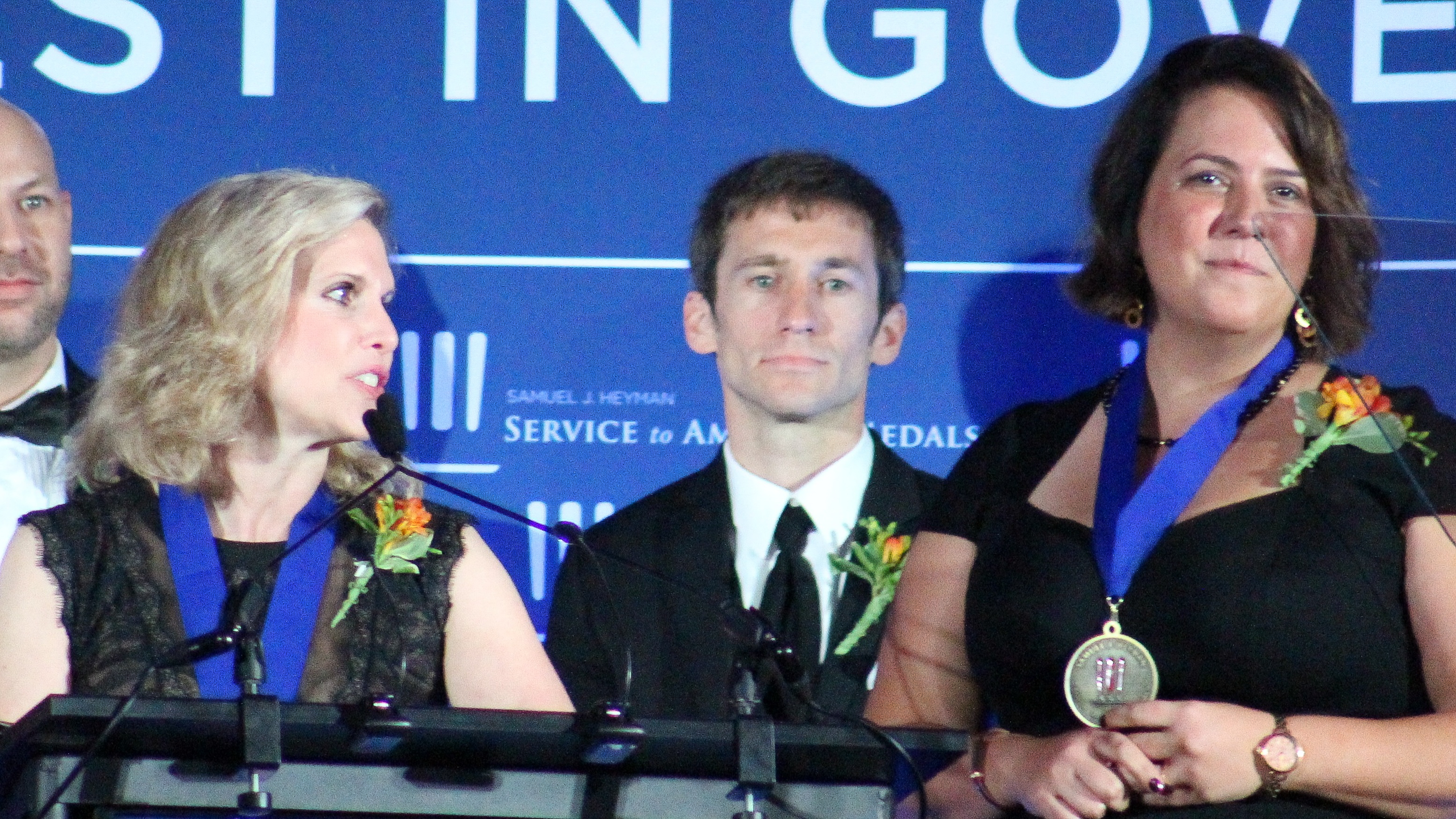 Karen Dodge, staff attorney at the Federal Trade Commission, and Margaret Moeser, senior trial attorney at the Department of Justice, accept the Homeland Security and Law Enforcement Medal at the 2018 Sammies Gala. (Jessie Bur/Staff)
