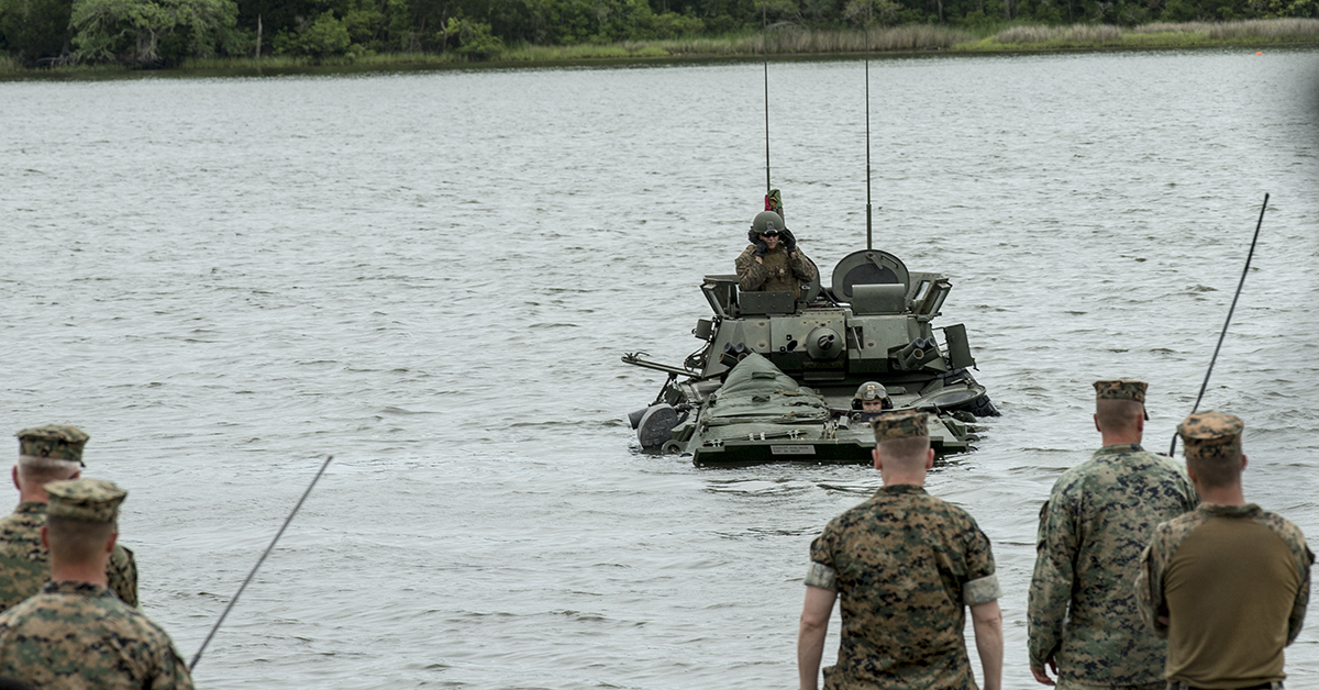 U.S. Marines with 2nd Light Armored Reconnaissance Battalion, 2nd Marine Division conduct a float test in Light Armored Vehicles during water obstacle negotiation training at Camp Lejeune, N.C., May 17, 2018. The event enhanced the Marines' abilities to maneuver through aquatic terrain in LAVs in preparation for potential real-world combat scenarios. (Pfc. Tyler M. Solak/Marines)