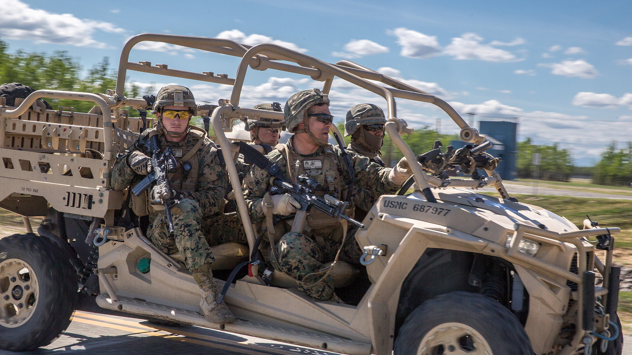 Staff Sgt. Juan Morales, front right, conducts a notional raid on a Polaris MRZR 4 vehicle on May 22, 2019, during exercise Northern Edge at Fort Greely, Alaska. (Cpl. Rhita Daniel/Marine Corps)
