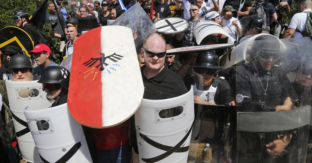 In this Aug. 12, 2017 file photo, white nationalist demonstrators use shields as they guard the entrance to Lee Park in Charlottesville, Virginia. (Steve Helber/AP)