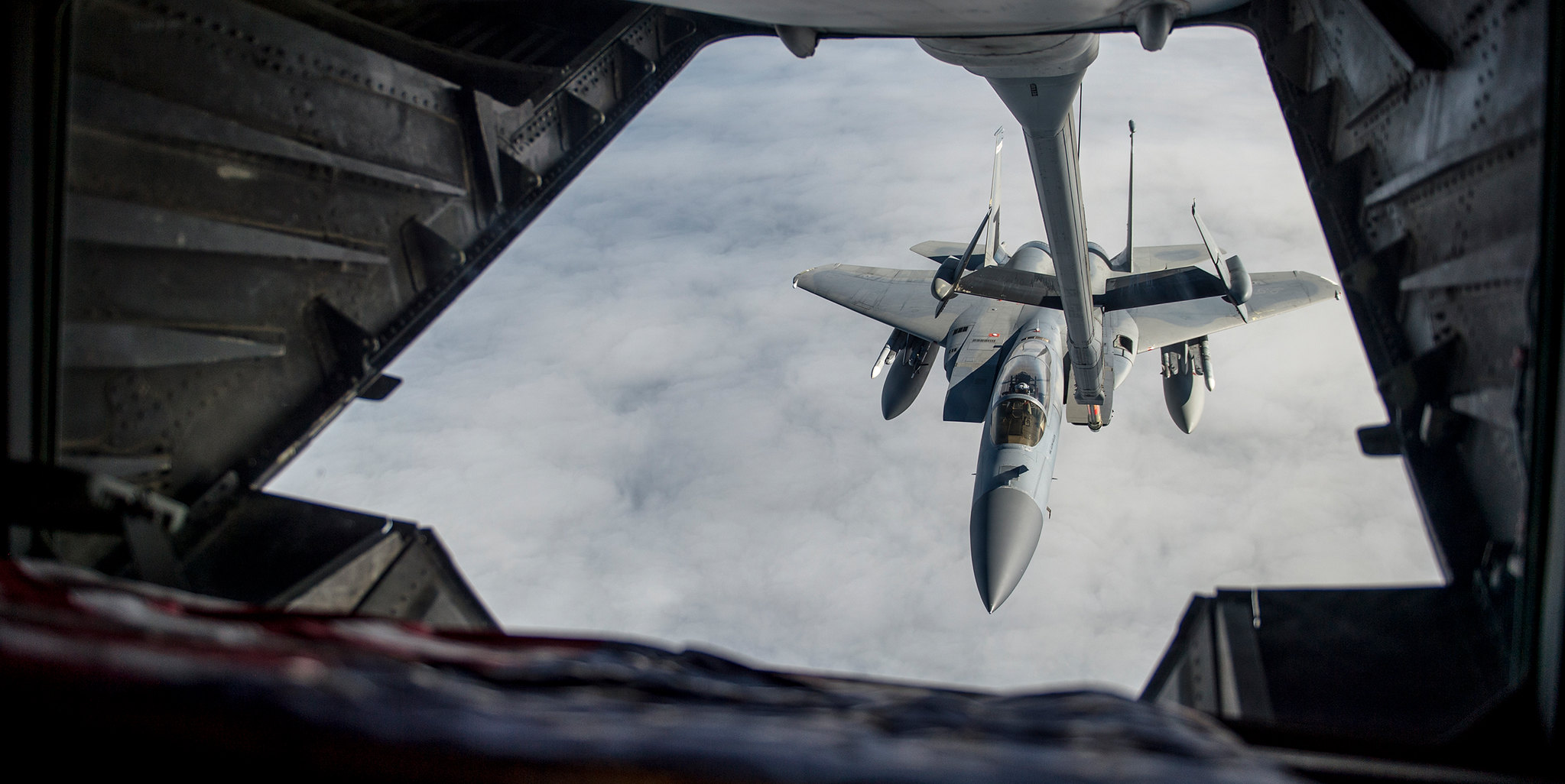 Airmen use a U.S. Air Force KC-10 Extender to refuel an F-15C Eagle as part of exercise Northern Edge on May 14, 2019, at Joint Base Elmendorf-Richardson, Alaska. (Master Sgt. Nathan Lipscomb/Air Force)