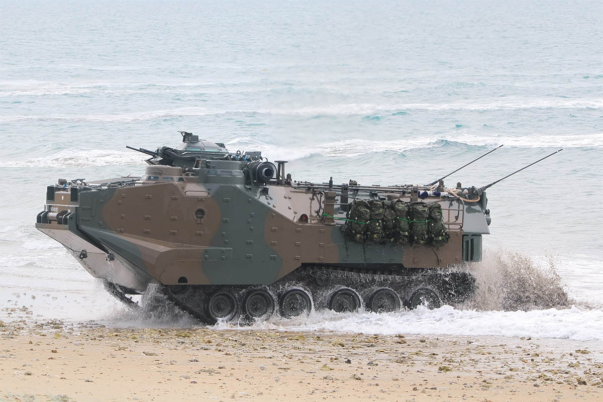 A Japan Ground Self-Defense Force amphibious assault vehicle emerges from the surf in Bowen, Australia, during an amphibious assault drill on July 22, 2019. Japan is taking part in the biannual exercise with the United States, Australia, New Zealand and other countries. (Mike Yeo/Staff)