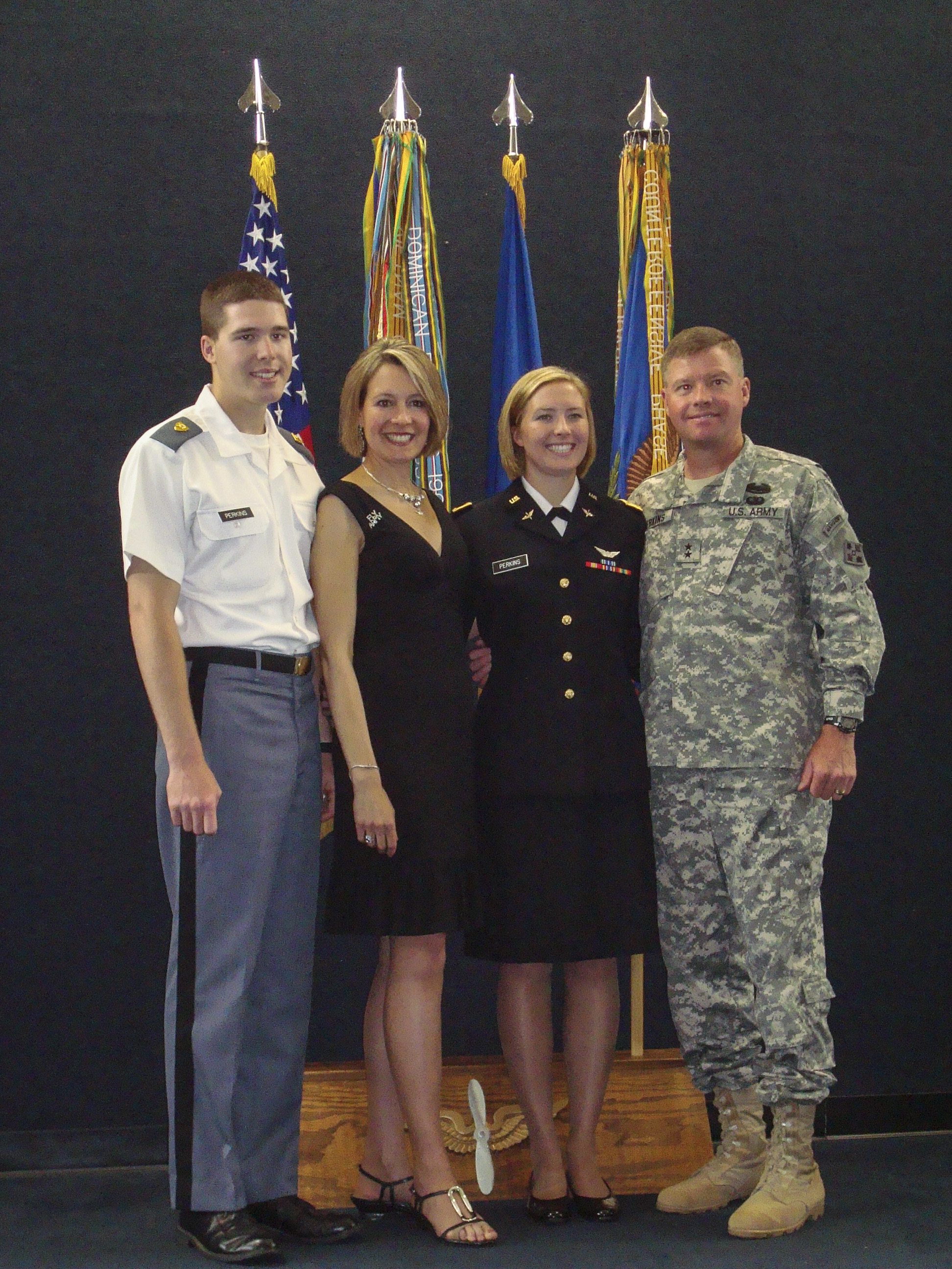 From left to right: USMA Cadet Chad Perkins, Mrs. Ginger Perkins, 1st Lt. Cassandra Perkins, and Maj. Gen. David Perkins, following 1st Lt. Perkins graduation from flight school at Fort Rucker in 2009.
