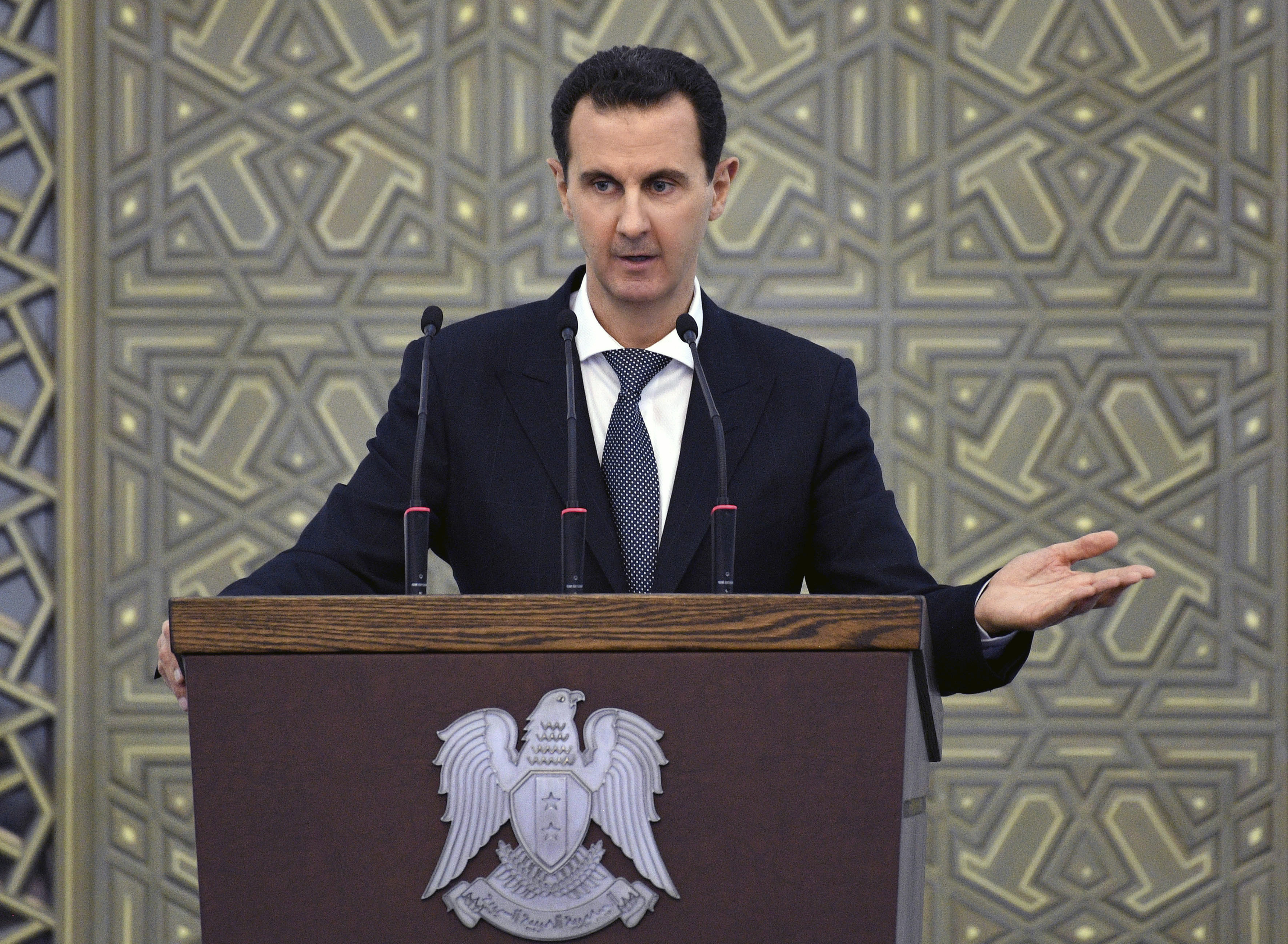 Syrian President Bashar Assad speaks during a Feb. 17, 2019, meeting with heads of local councils from all Syrian provinces, in Damascus. (SANA via AP)