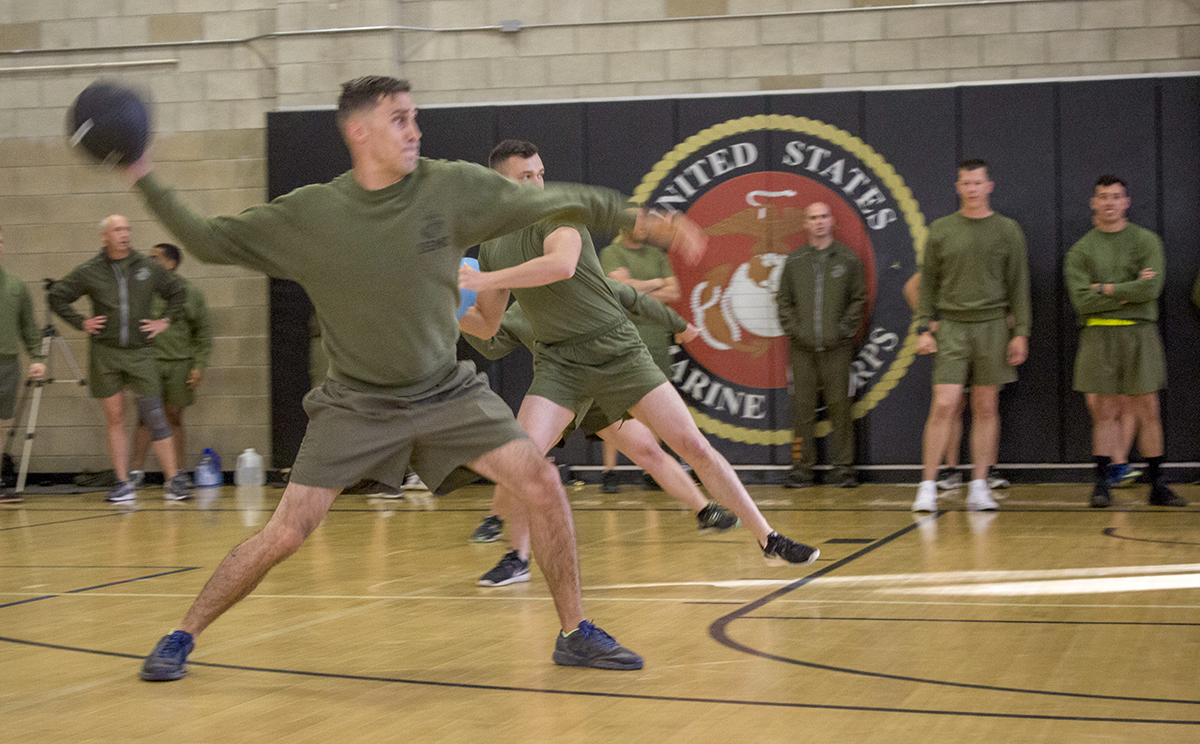 U.S. Marines and Sailors with the 15th Marine Expeditionary Unit play dodgeball during Resiliency Training at Marine Corps Base Camp Pendleton, California, Friday, April 20, 2018. The unit's resiliency program is designed to foster camaraderie and unit cohesion, where each member participates in scenario-based guided discussions on topics pertaining to inspire and maintain resiliency within the unit, at the conclusion of the physical training session. (U.S. Marine Corps photo by Capt. Maida Zheng)
