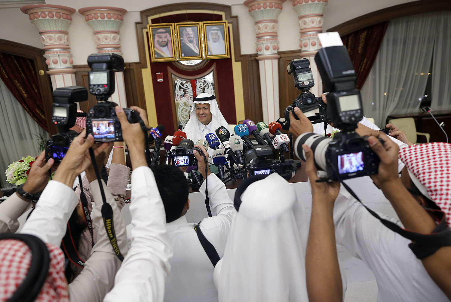 Saudi Energy Minister Prince Abdulaziz bin Salman, is surrounded by photographers as he enters a press conference in Jiddah, Saudi Arabia, Tuesday, Sept. 17, 2019. (Amr Nabil/AP)
