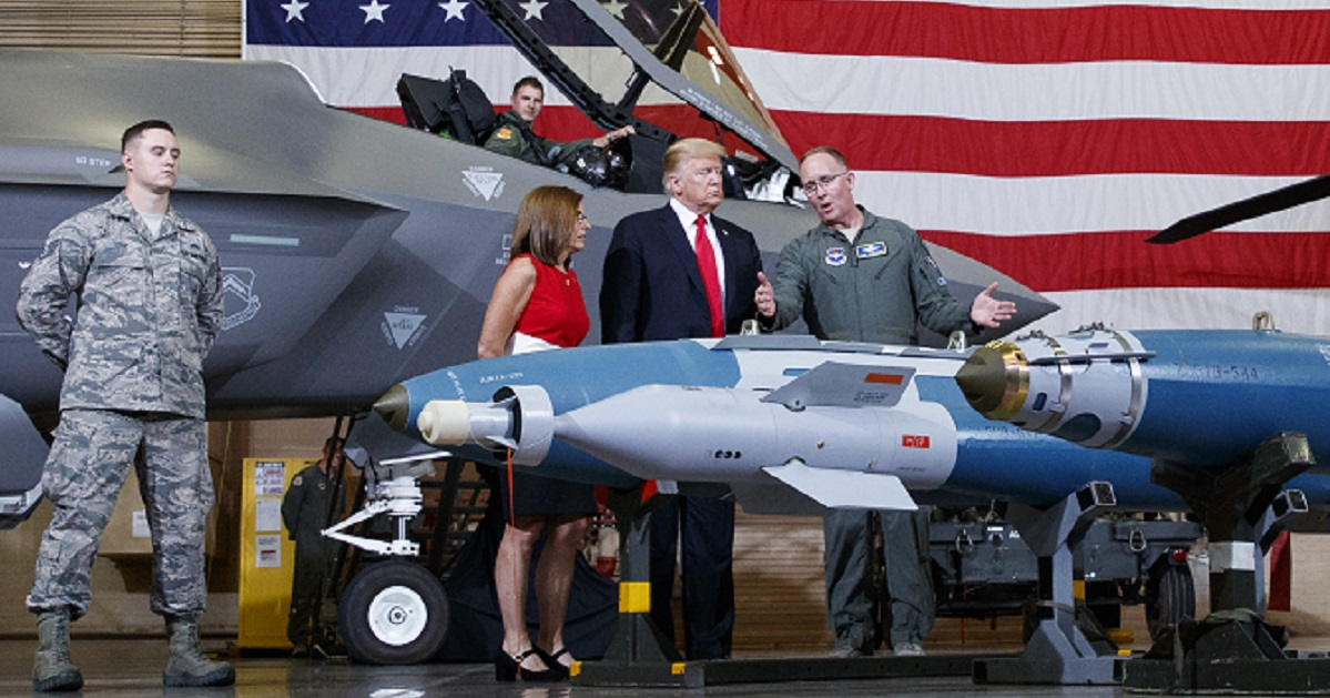 Brig. Gen. Todd Canterbury, 56th Fighter Wing commander, briefs the president on the capabilities of the GBU-12 bomb. (Carolyn Kaster/AP)