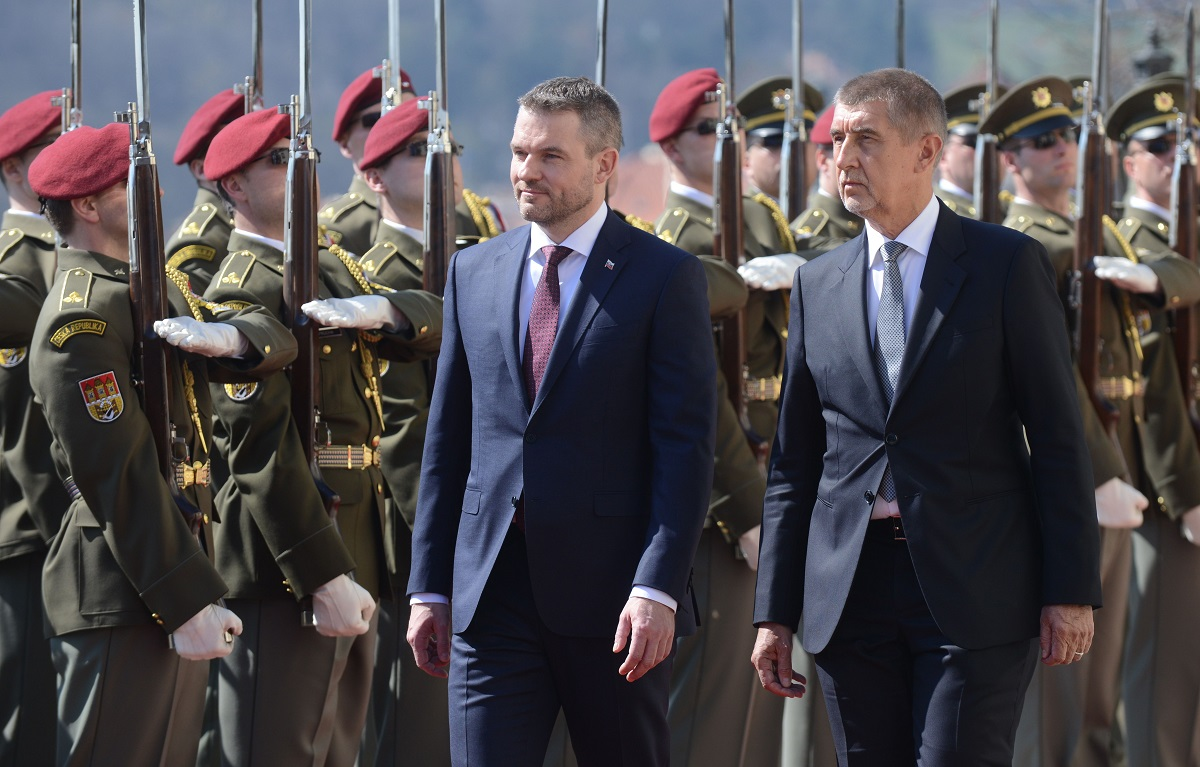 Czech Prime Minister Andrej Babis, right, and his Slovak counterpart, Peter Pellegrini, review an honor guard before their meeting on April 11, 2018, in Prague. (Michal Cizek/AFP via Getty Images)