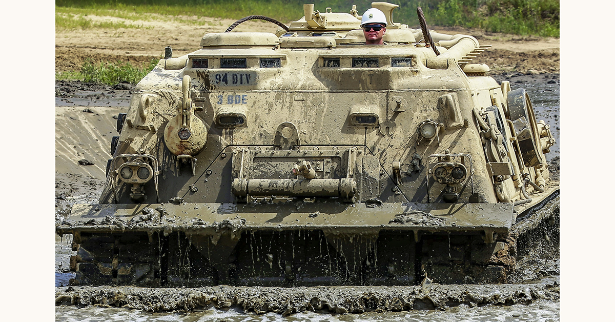 Sgt. 1st Class Timothy Phillips, senior instructor and writer with Regional Training Site (RTS)-Maintenance, drives an M88A1 Medium-Tracked Recovery Vehicle during operations for the Tracked Vehicle Recovery Course on July 19, 2018, at a training area on North Post at Fort McCoy, Wis. (Scott T. Sturkol/Army.)